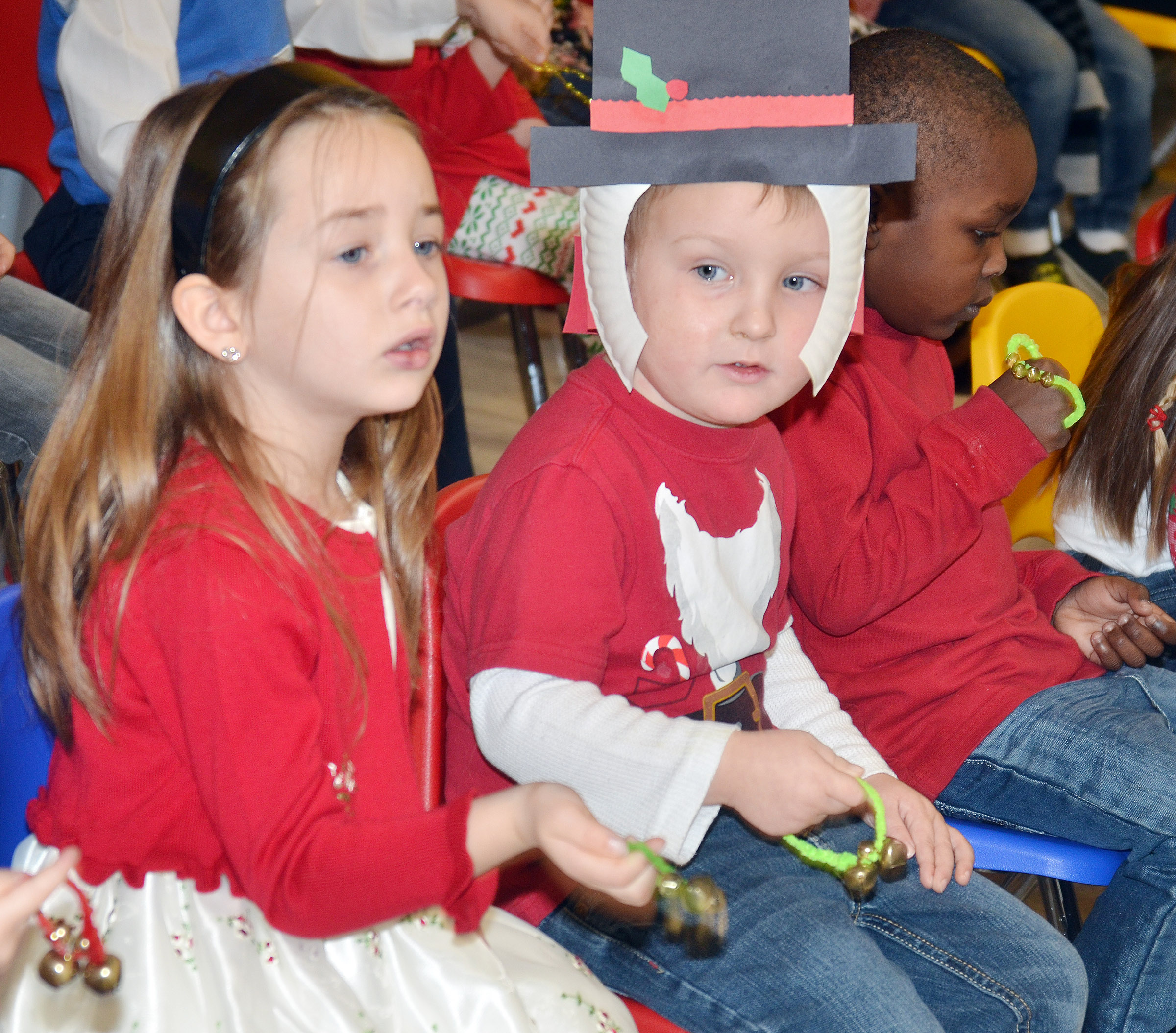 CES preschool students Lylah Davis, at left, and Gannon Scott sing Christmas songs.