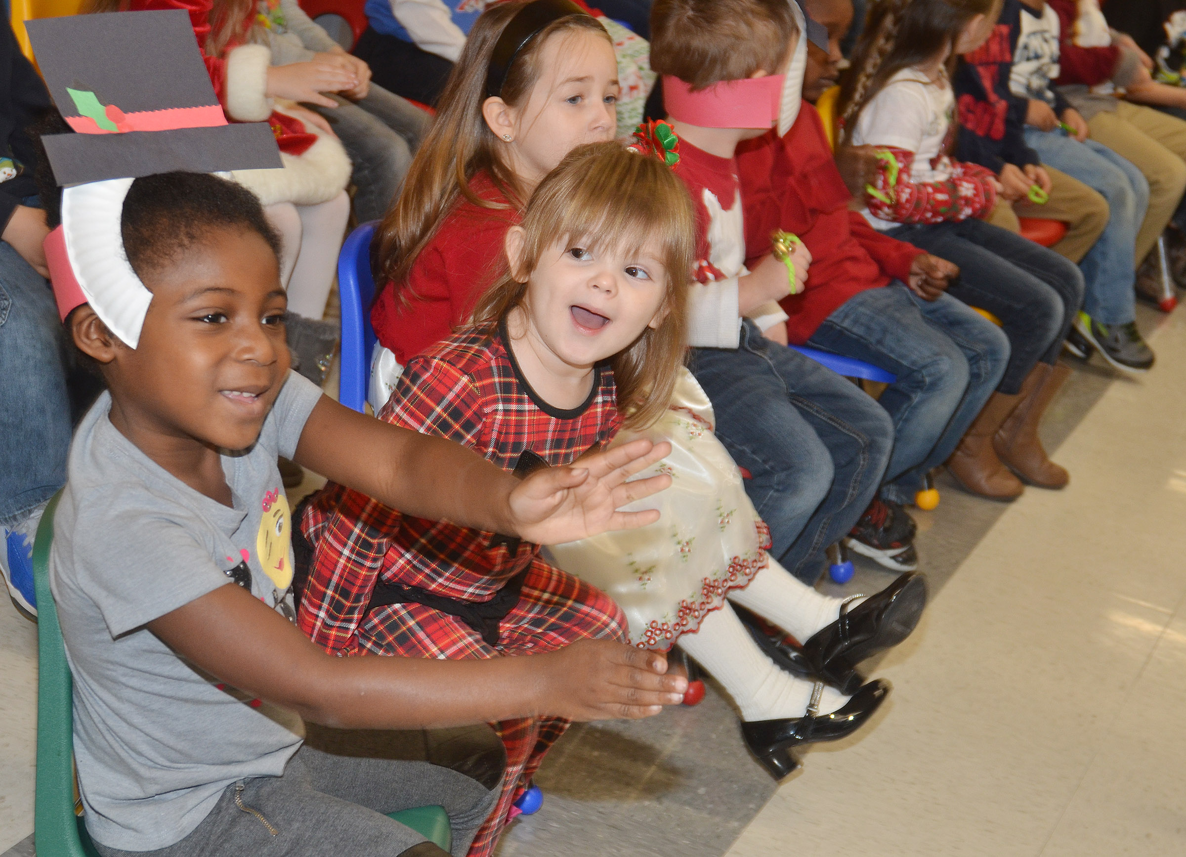 CES preschool students Harmony Brown, at left, and Lirra Berry sing Christmas songs.