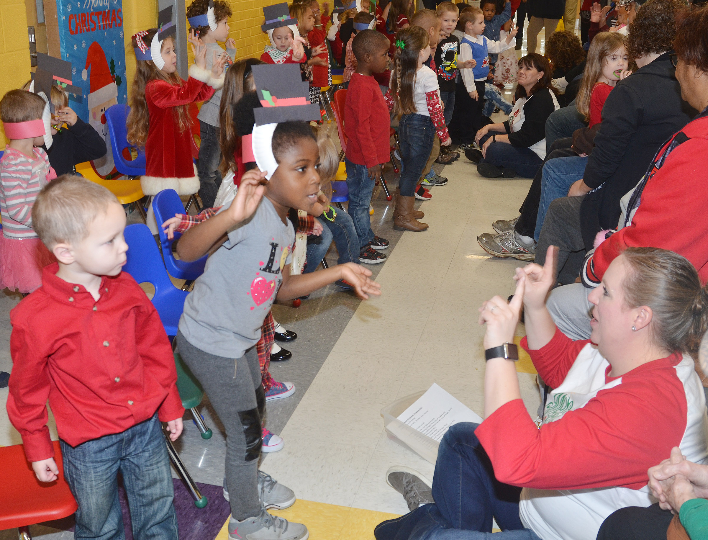 CES preschool student Harmony Brown sings Christmas songs with her classmates.