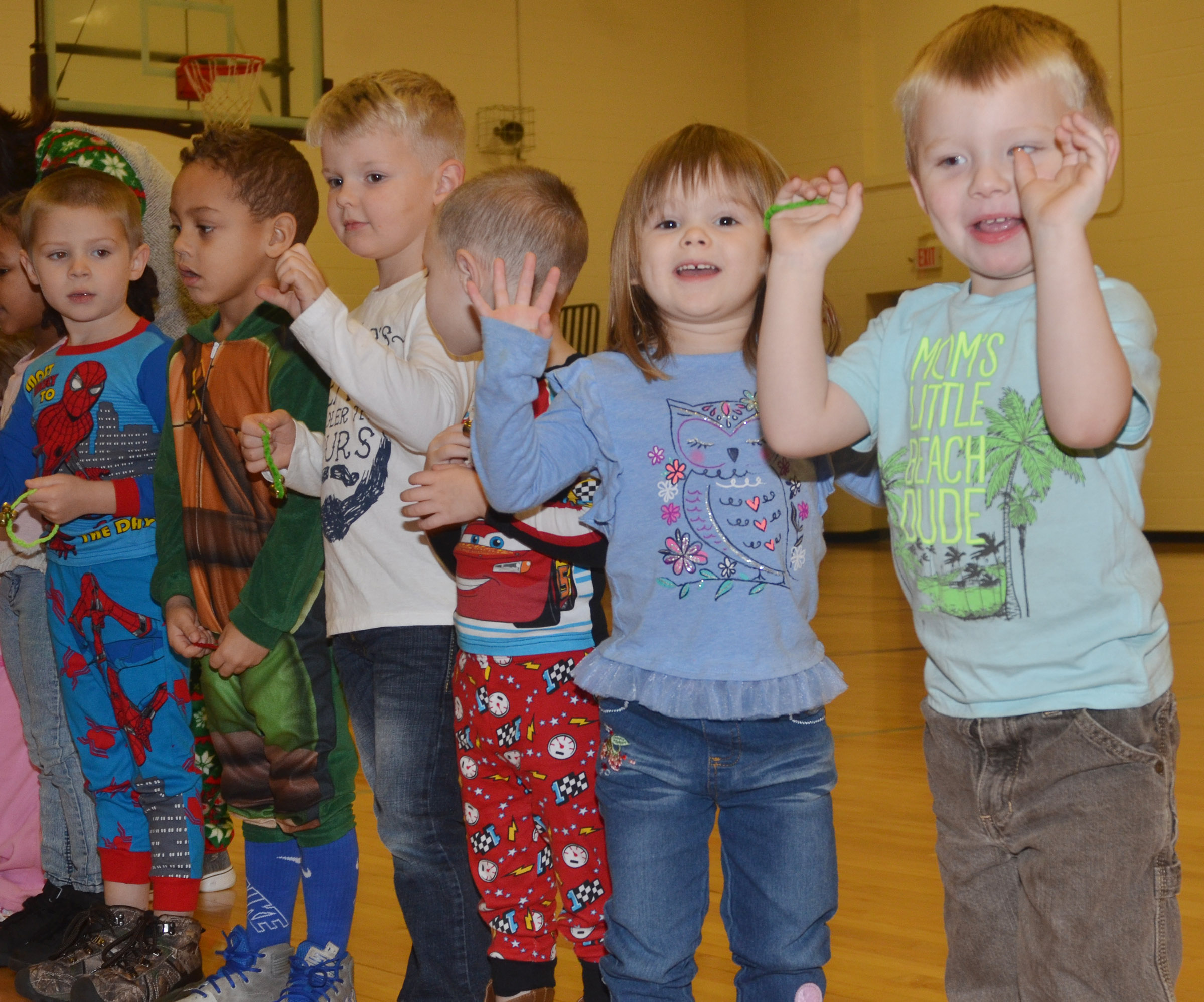 CES preschool students Julie Lasater, at left, and Landon Allen perform with their classmates.
