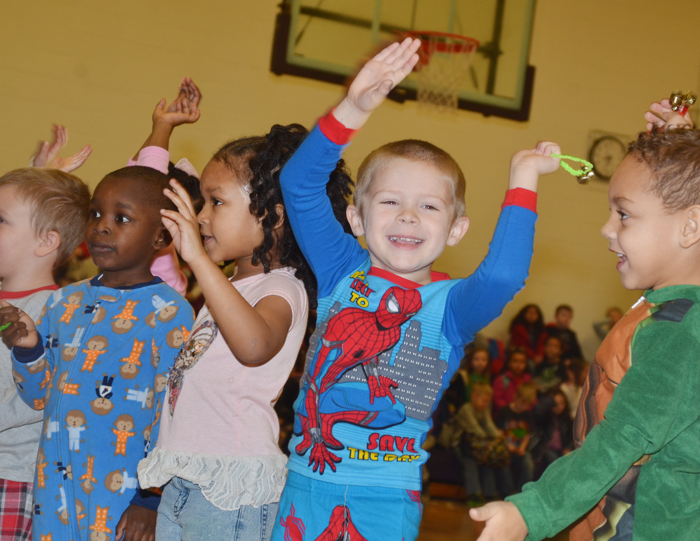 CES preschool student Brian Daniels performs with his classmates.