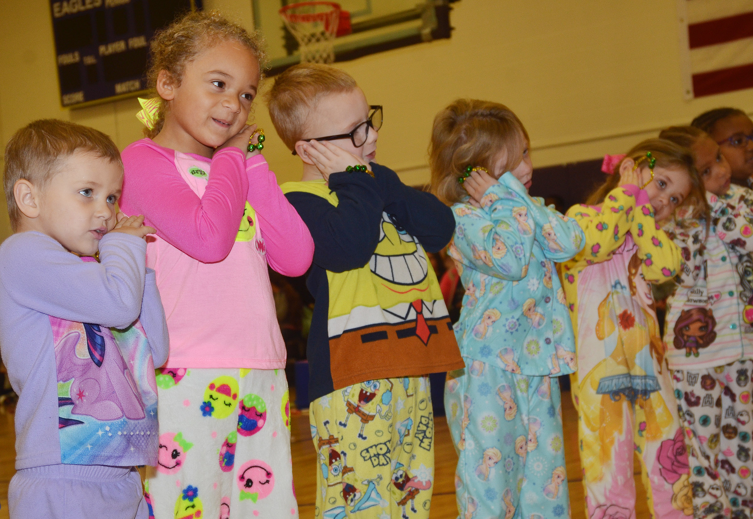 CES preschool students Elliana Morton, Layla Barbee and Anthony McClure perform with their classmates.