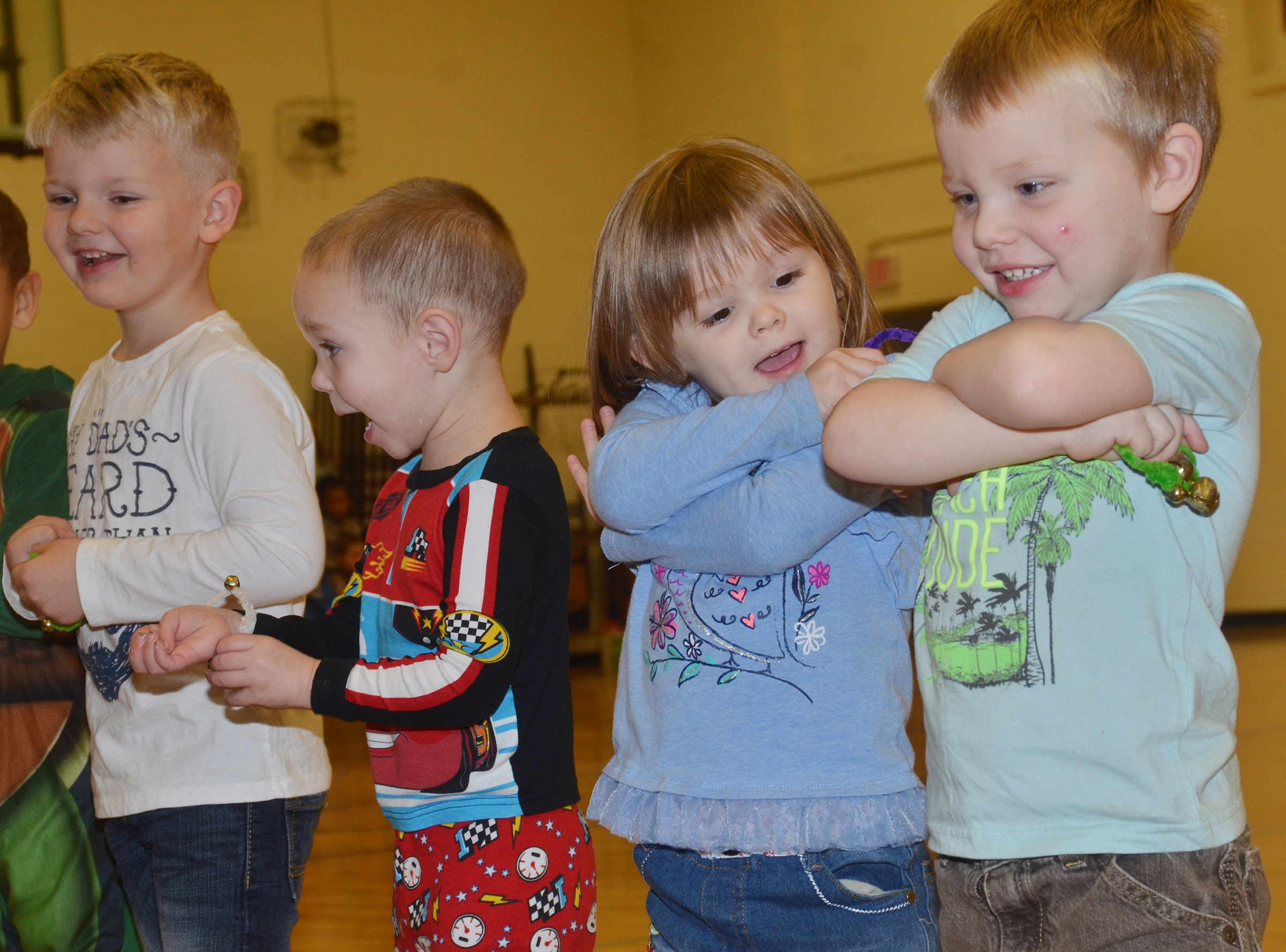 From left, CES preschool students Hoyt Davis, Cole Britton, Julie Lasater and Landon Allen perform with their classmates.