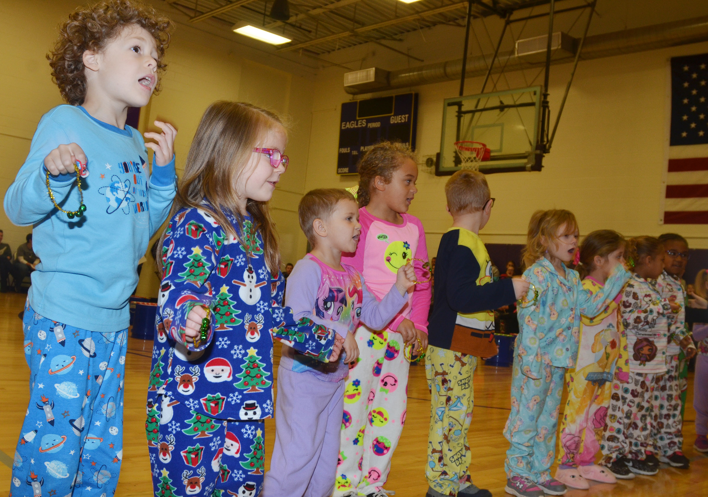 CES preschool student Zyron Young, at left, performs with his classmates.