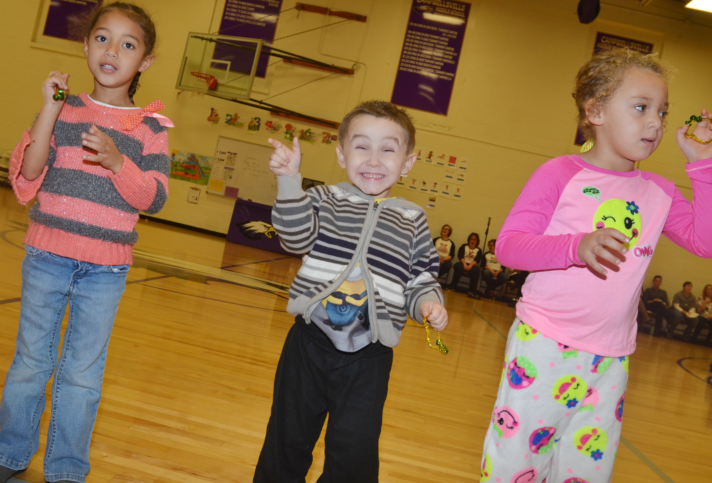 CES preschool students, from left, Onyx Hunter, Noelan McMahan and Jayla Barbee perform with their classmates.