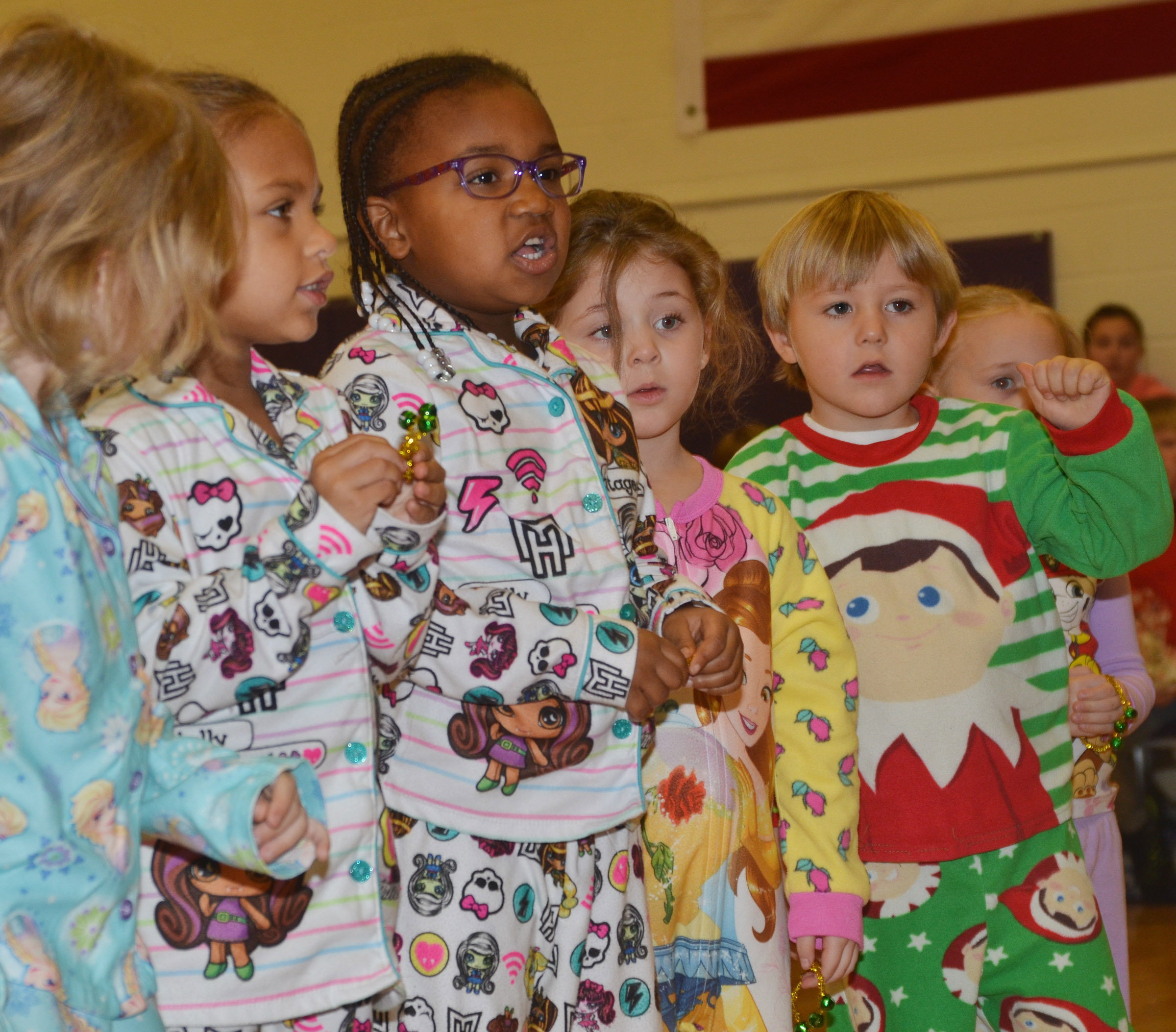From left, CES preschool students Adaia Taylor, Kyona Mitchell, Mila Moss and Bentley Cox perform.