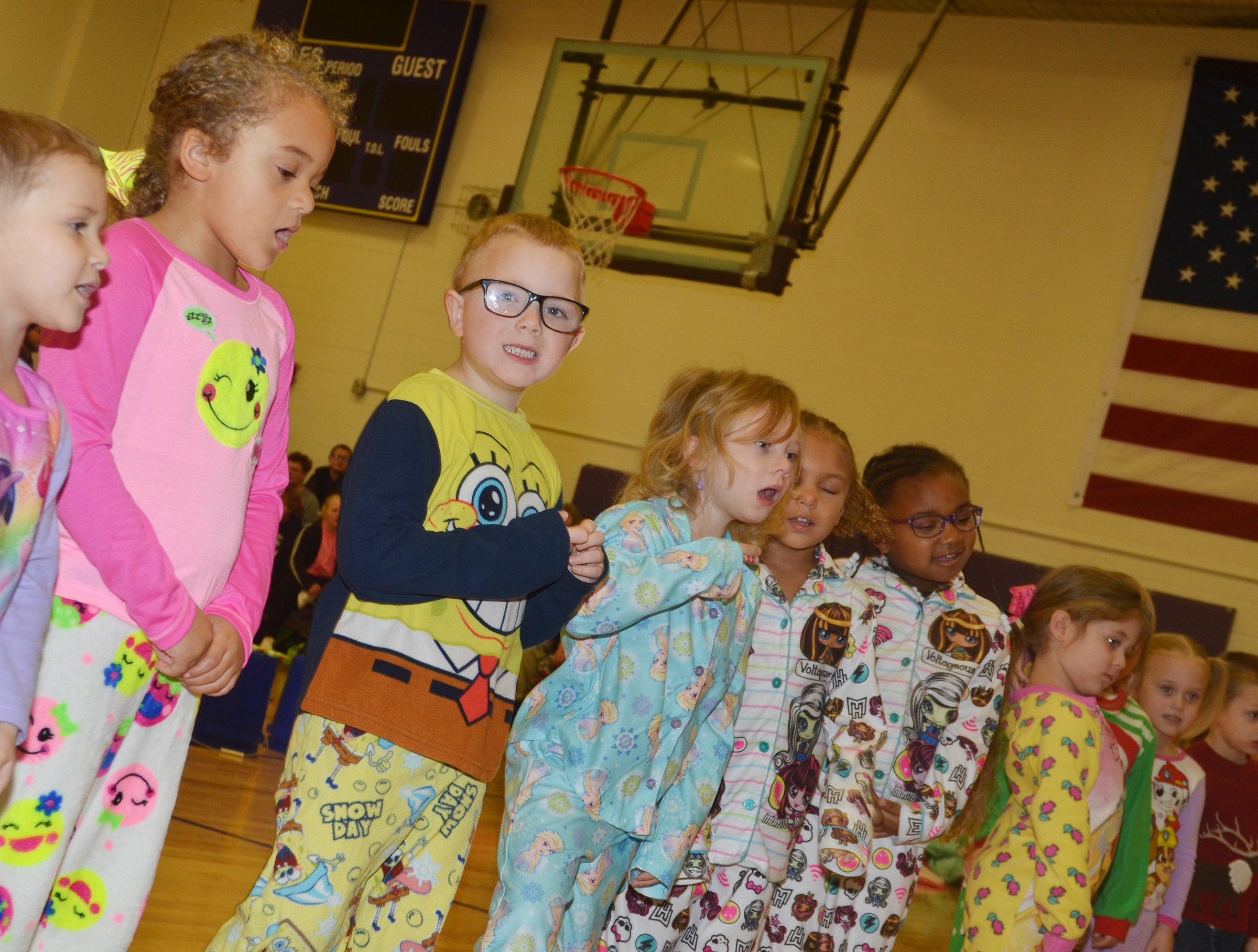 CES preschool student Anthony McClure smiles as he performs with his classmates.