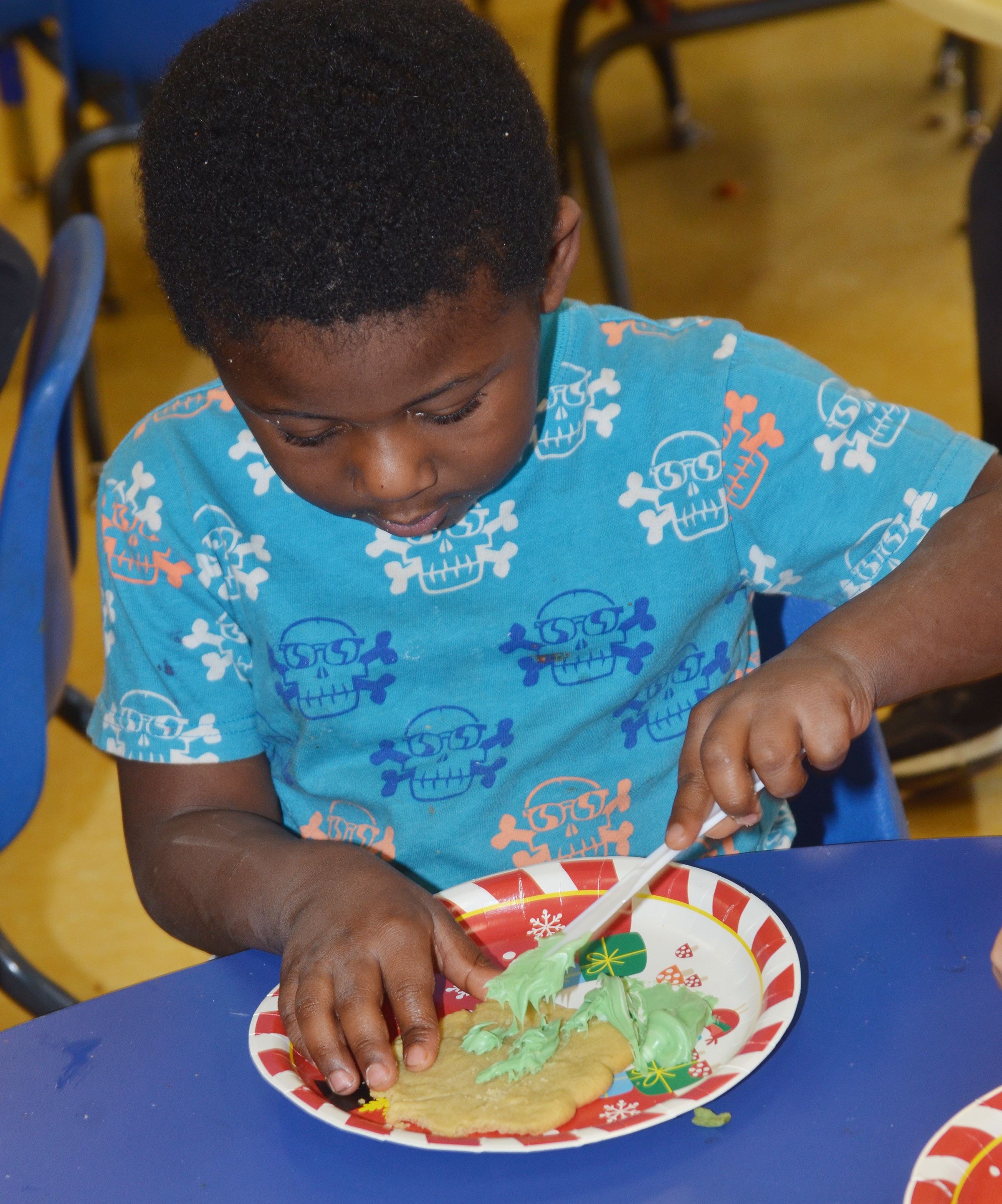CES preschool student LaTayvion Brown decorates his cookie.
