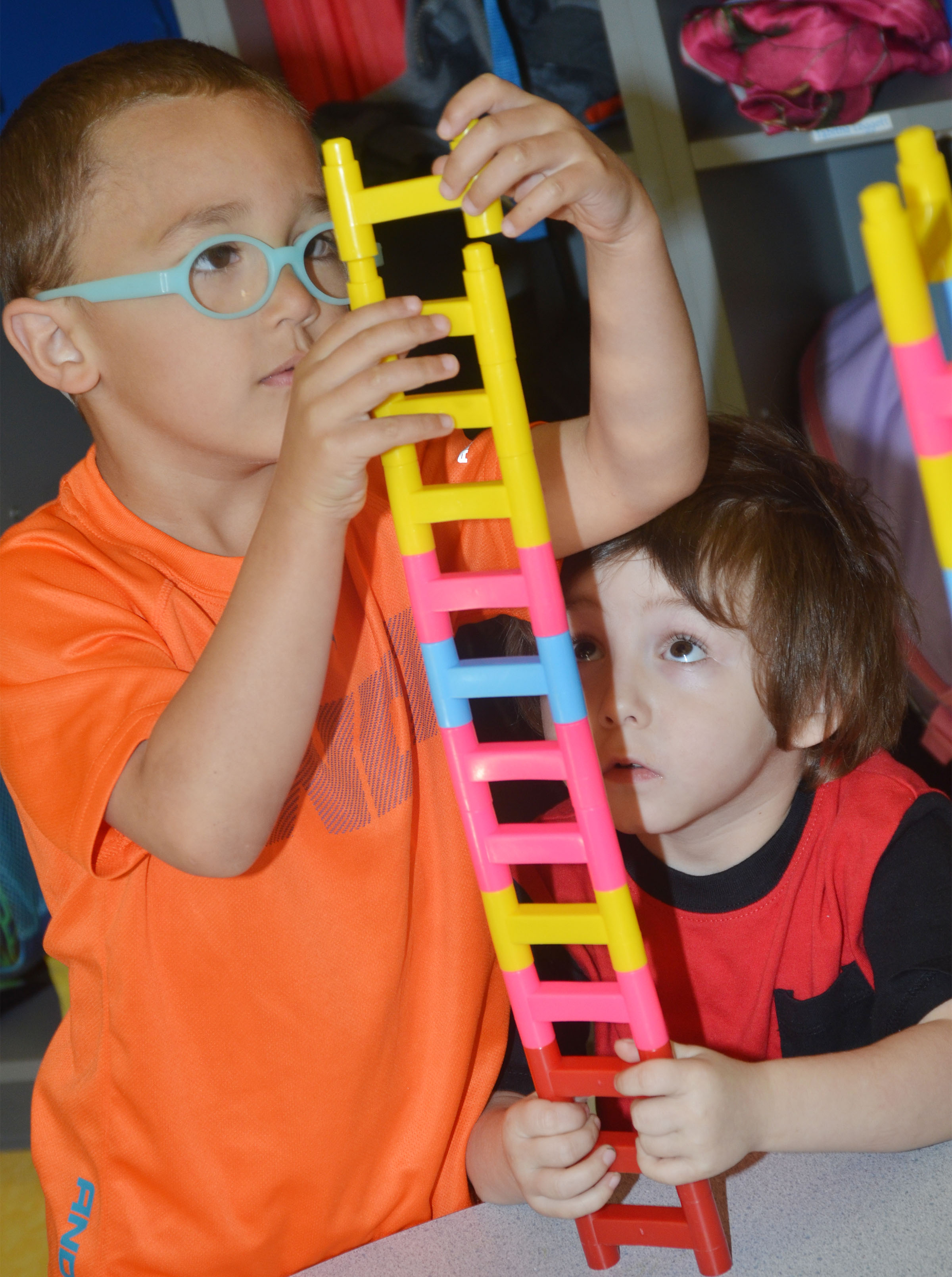 CES preschool student Chanler Mann, at left, and Noelan McMahan build together.