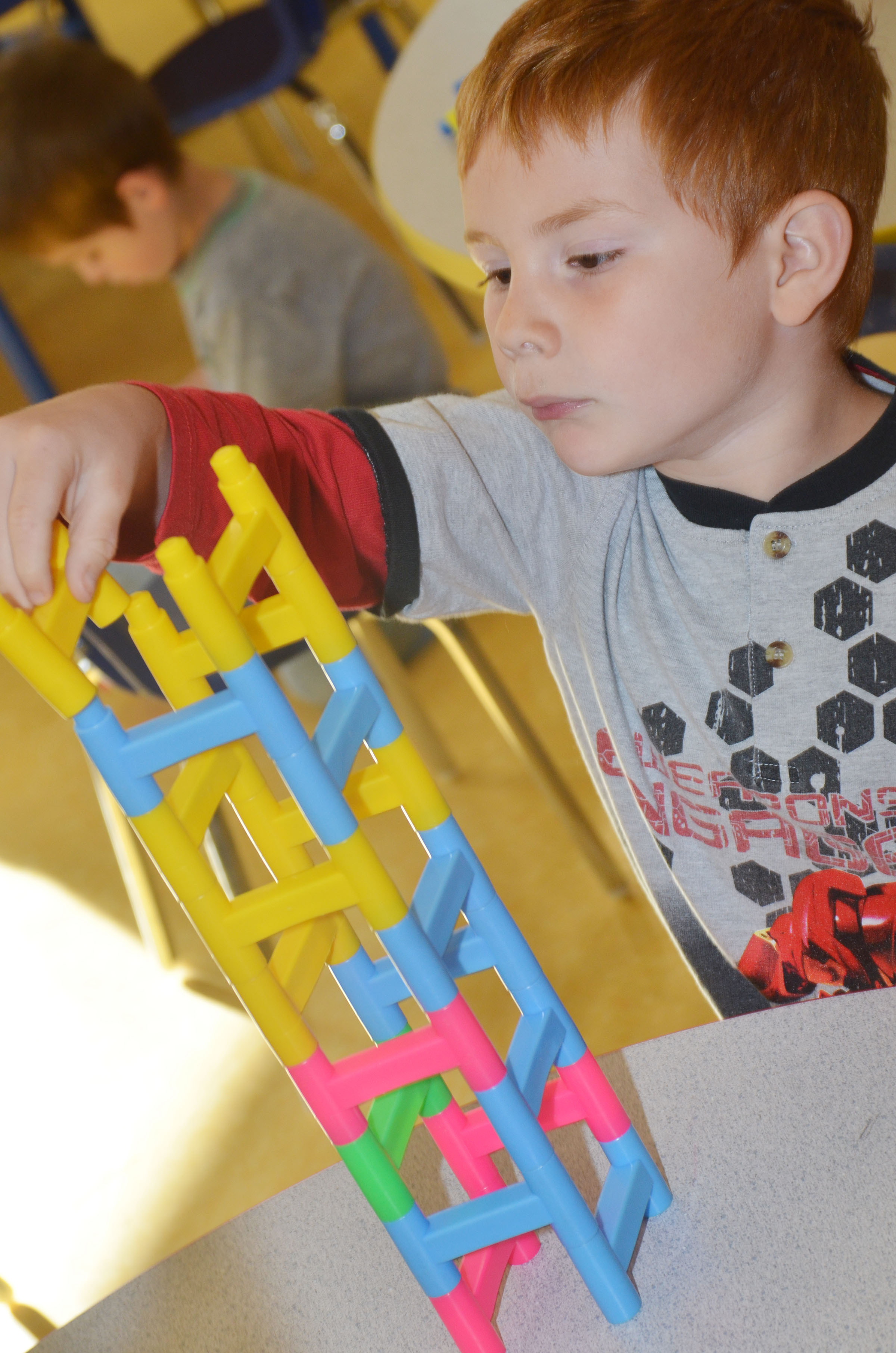 CES preschool student Kennon Dotson builds.