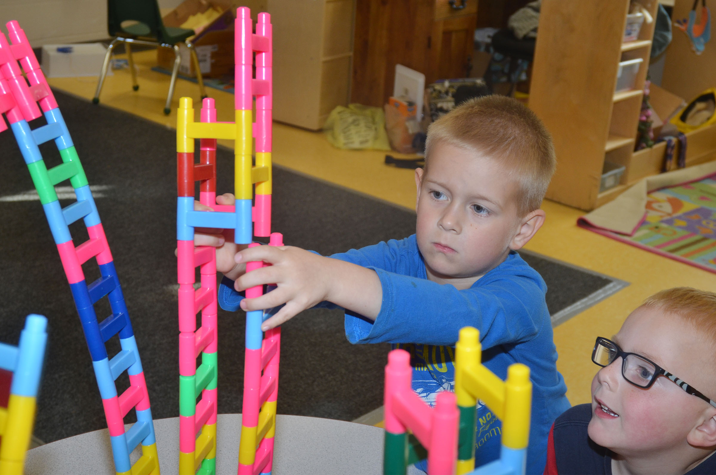 CES preschool students Jacob Parrish, at left, and Anthony McClure build.