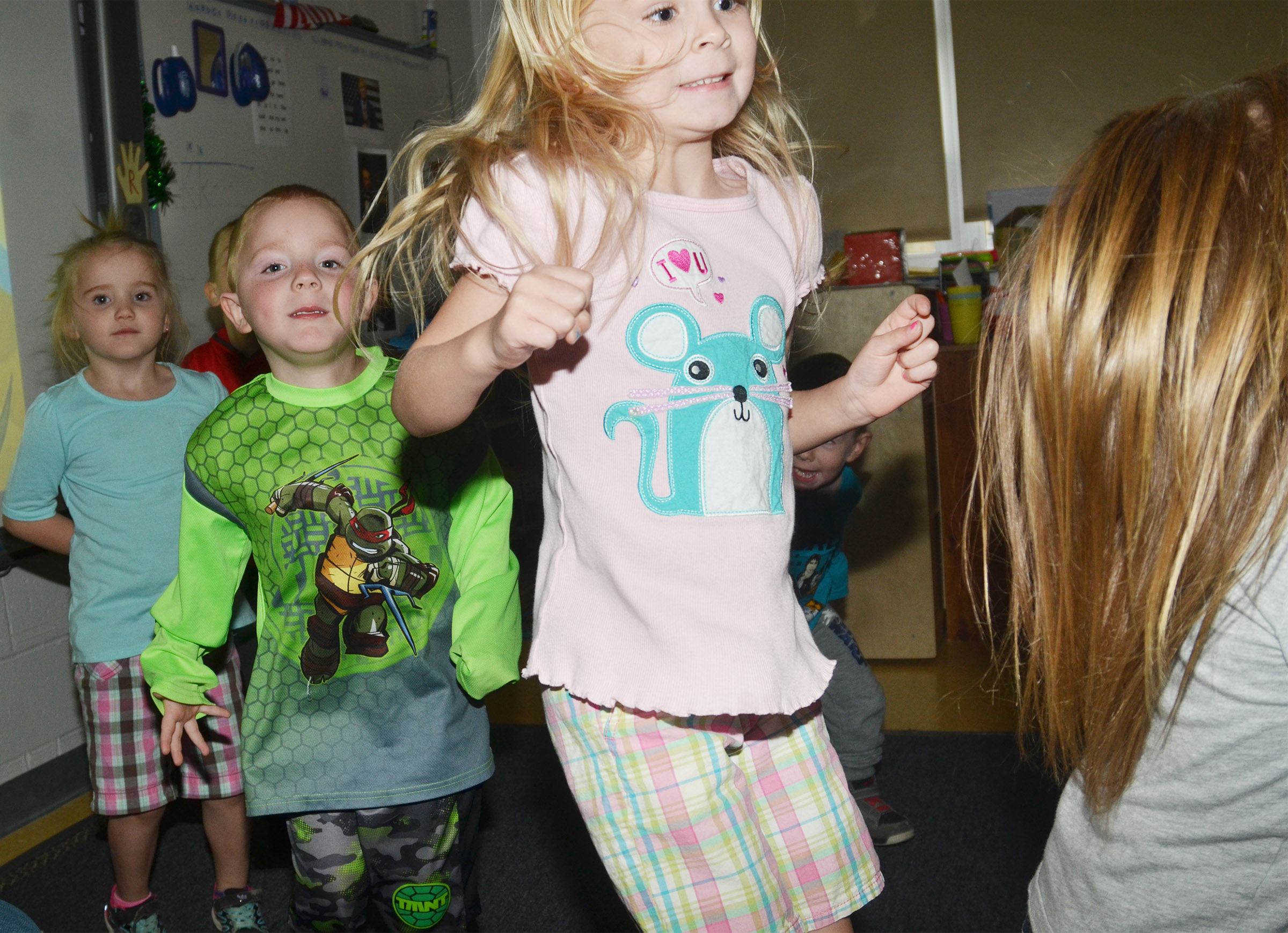 CES preschool student Alinna Bray dances with her classmates Trinity Dye, at left, and Anthony McClure.
