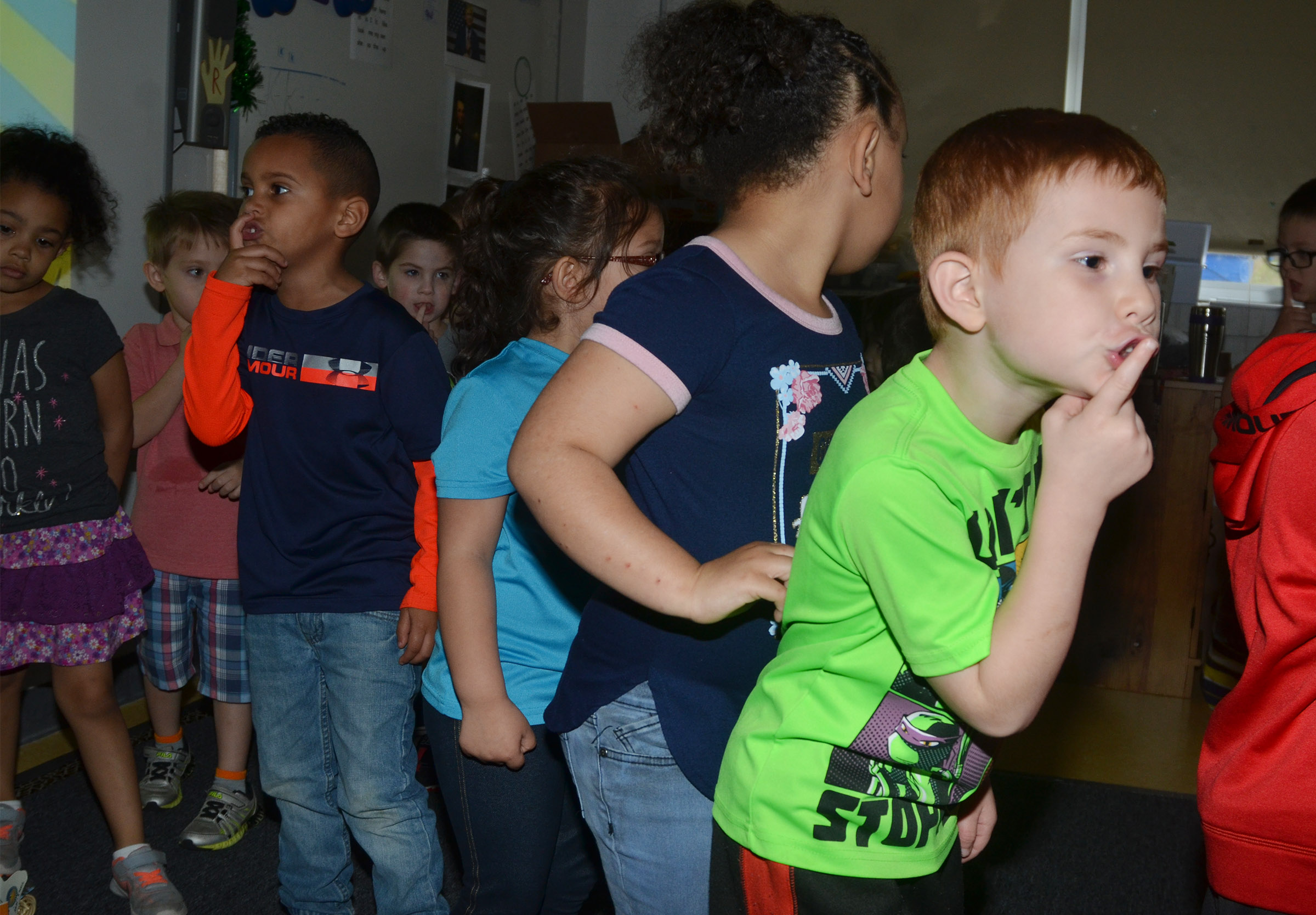 CES preschool student Kennon Dotson and his classmates dance in a circle as they are asked to be quiet.
