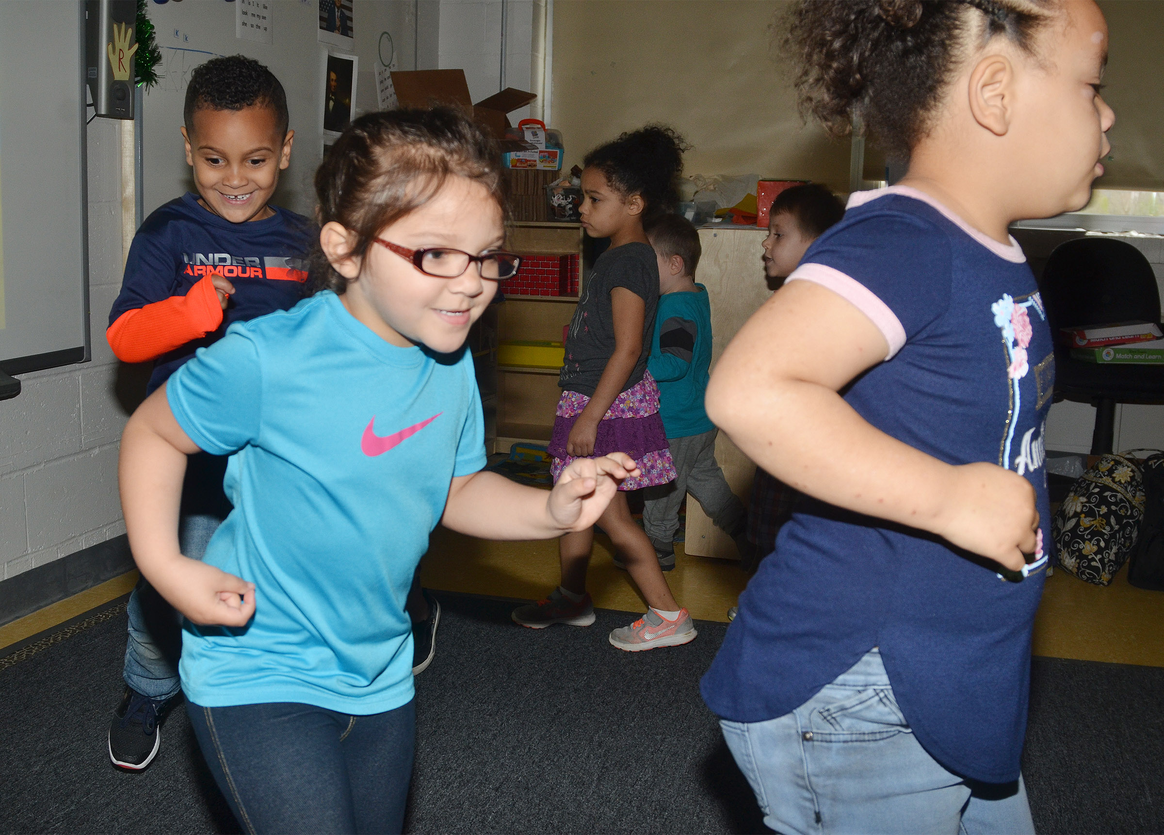 From left, CES preschool students Kingston Cowherd, Rylee Karr and Lillian Merriweather dance together.