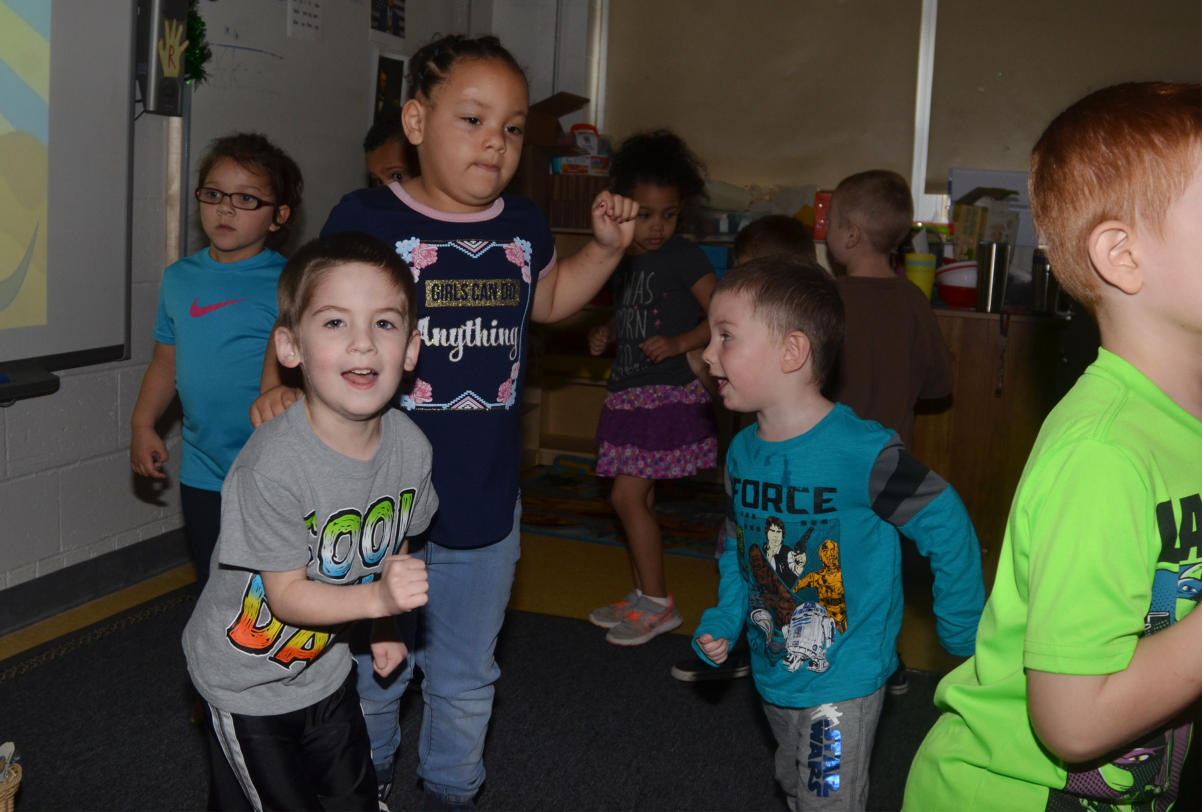 CES preschool students Charlie Woodbury, at left, and Chase Arnett dance together.