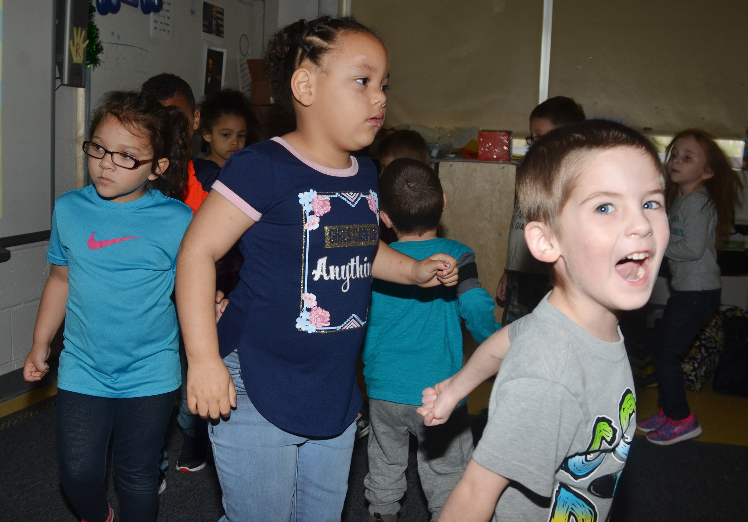 CES preschool student Charlie Woodbury has fun as he and his classmates dance together.