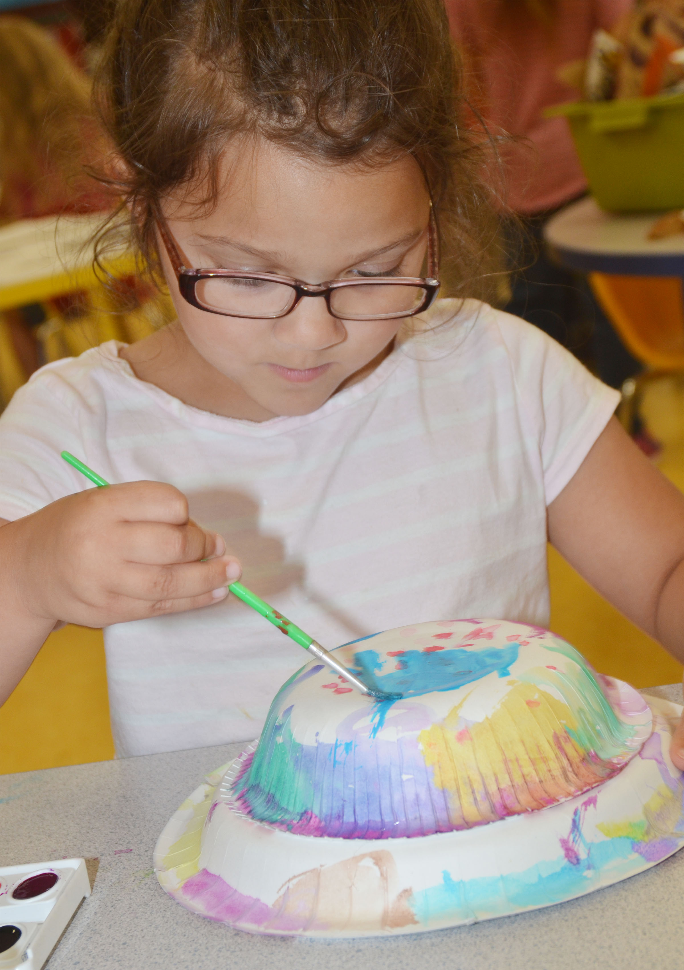 CES preschool student Addisyn Taylor paints her Derby hat.