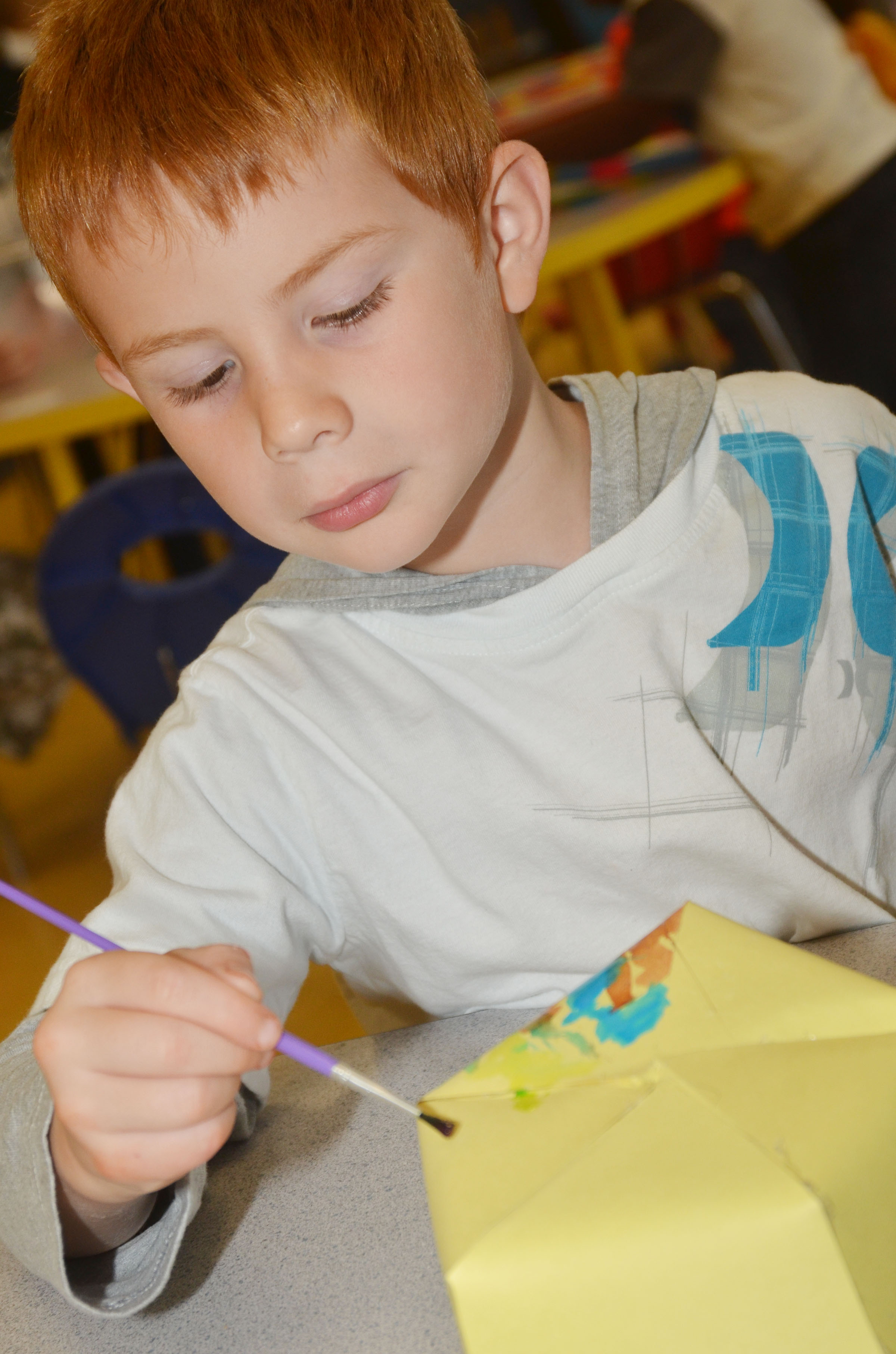 CES preschool student Kennon Dotson paints his Derby hat.