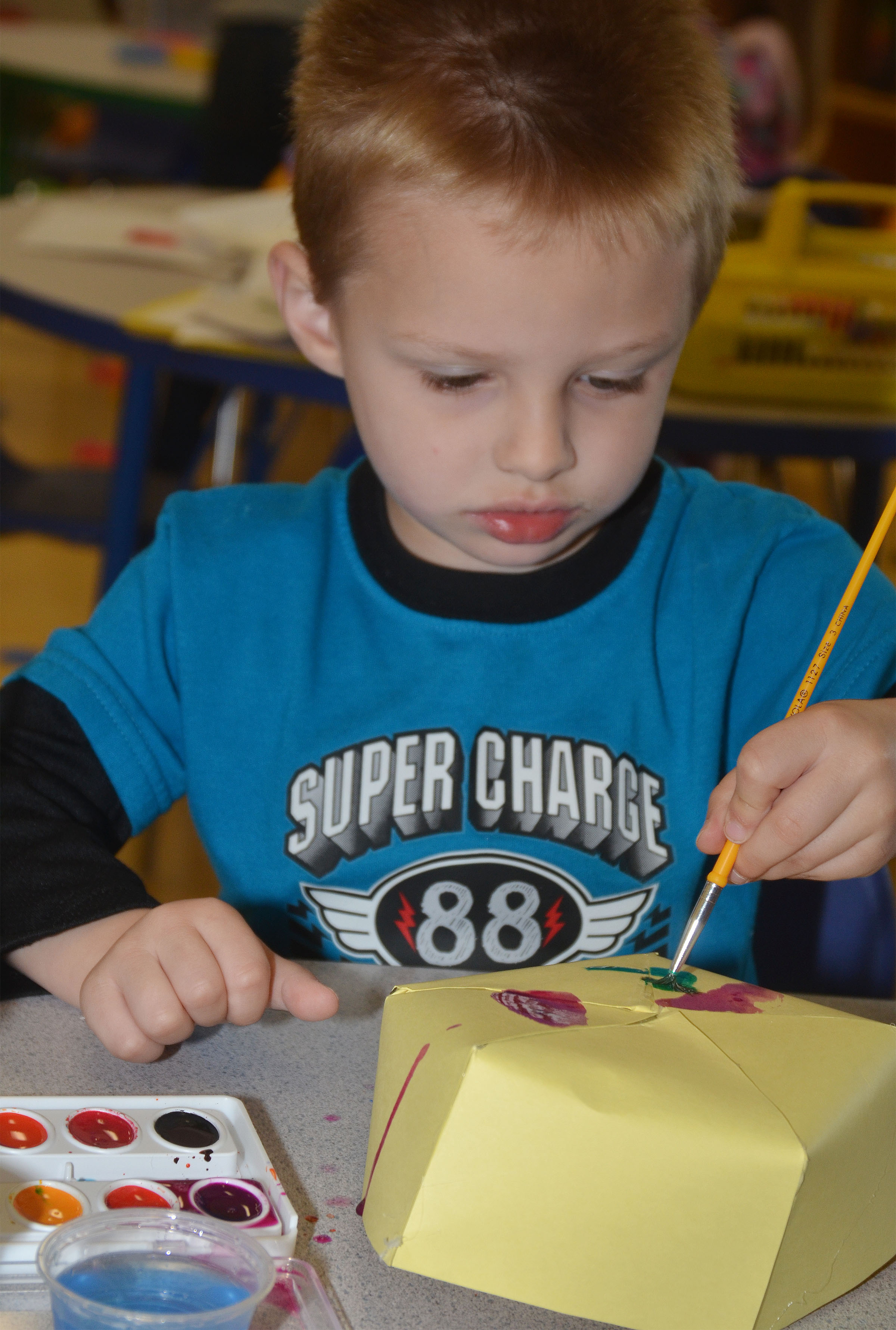 CES preschool student Nevon Stum paints his Derby hat.