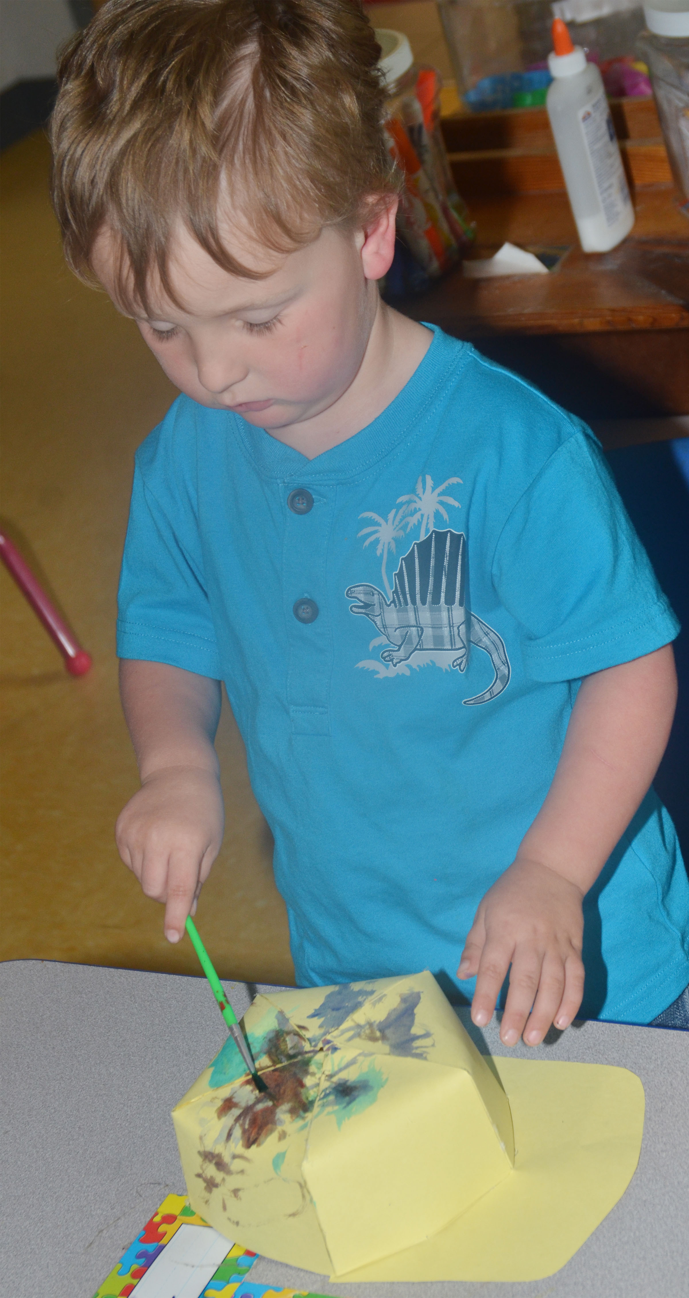 CES preschool student Gannon Scott paints his Derby hat.