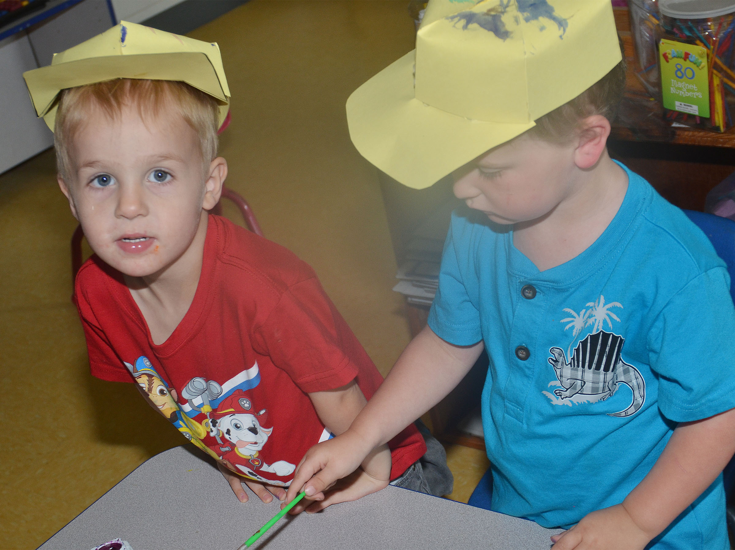 CES preschool students Chase Russell, at left, and Gannon Scott wear their Derby hats.