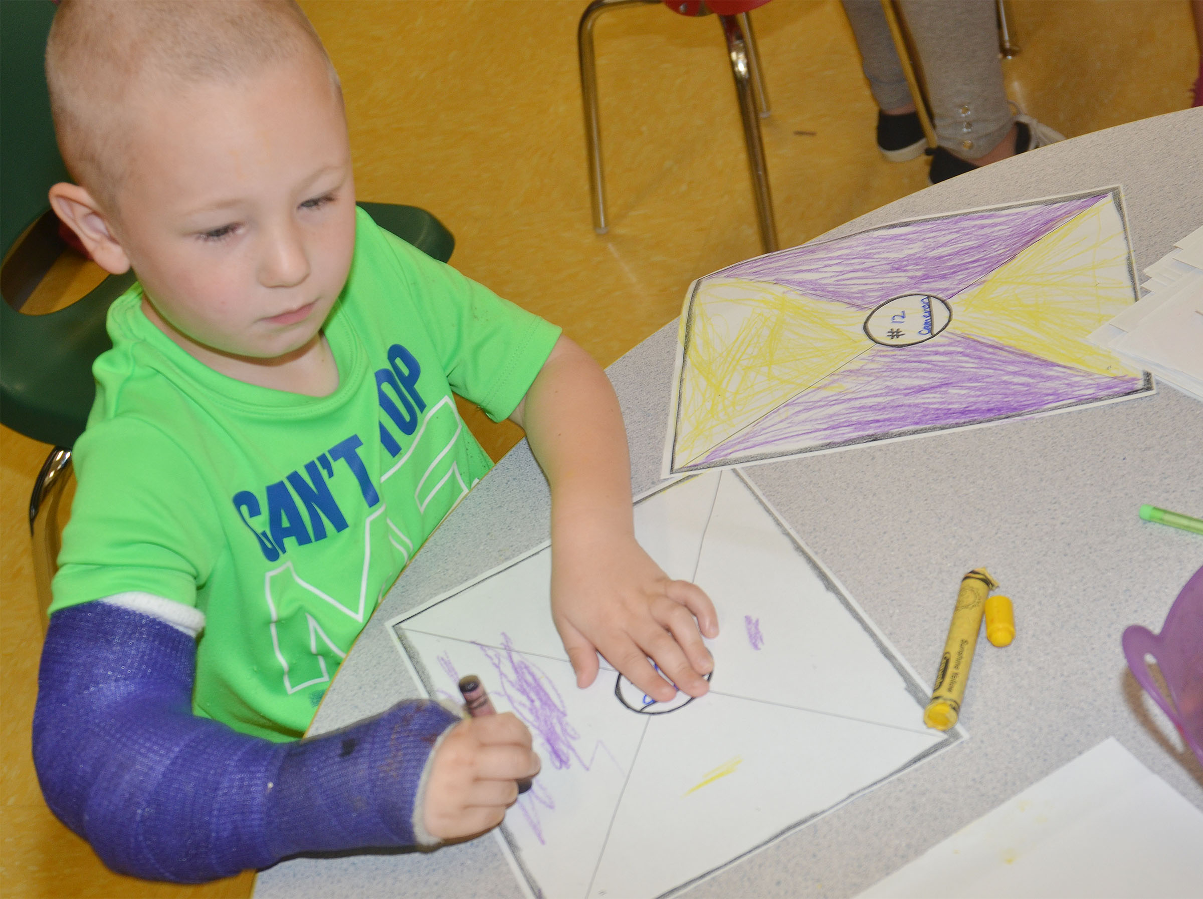 CES preschool student Cameron Dean colors his Derby silk.