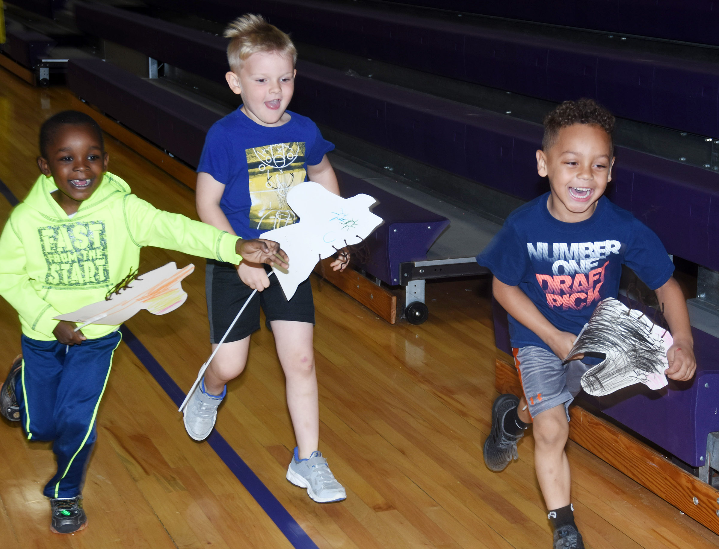 From left, CES preschool students Xavien Smith, Hoyt Davis and Jasiahas Anderson race.
