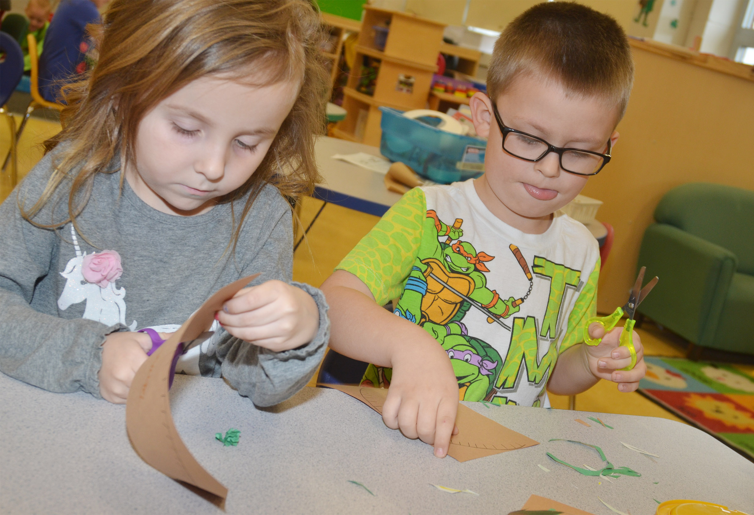 "CES preschool students Tabitha Leggett, at left, and Reece Williams cut out their nests for their ""Are You My Mother?"" project."