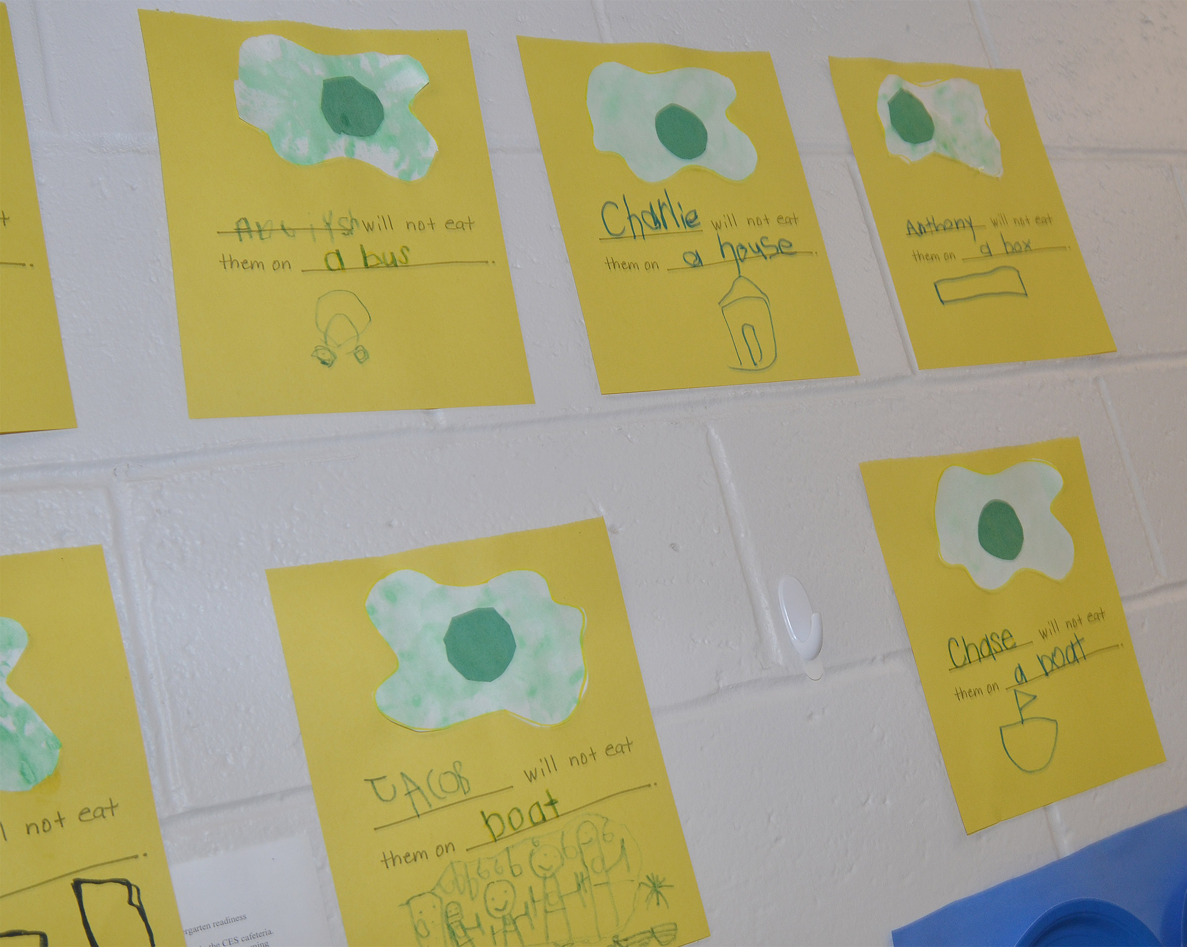 "CES preschoolers' ""Green Eggs and Ham"" projects are on display. They were asked where they wouldn't eat green eggs and ham."