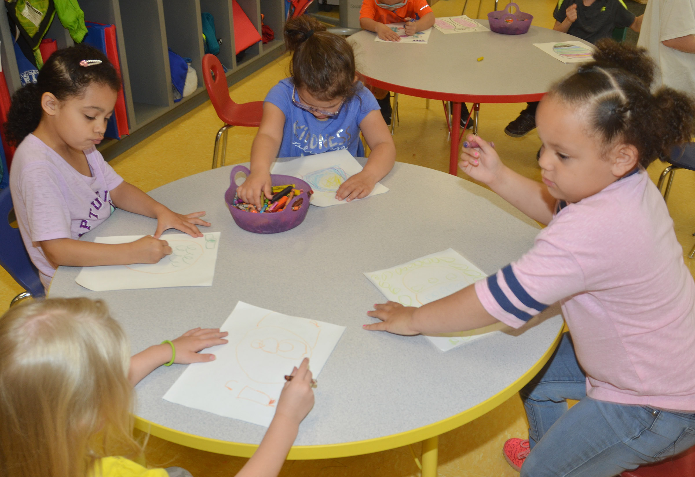 From left, CES preschool students Alinna Bray, Rylee Karr, Addisyn Taylor and Lillian Merriweather draw Easter eggs.