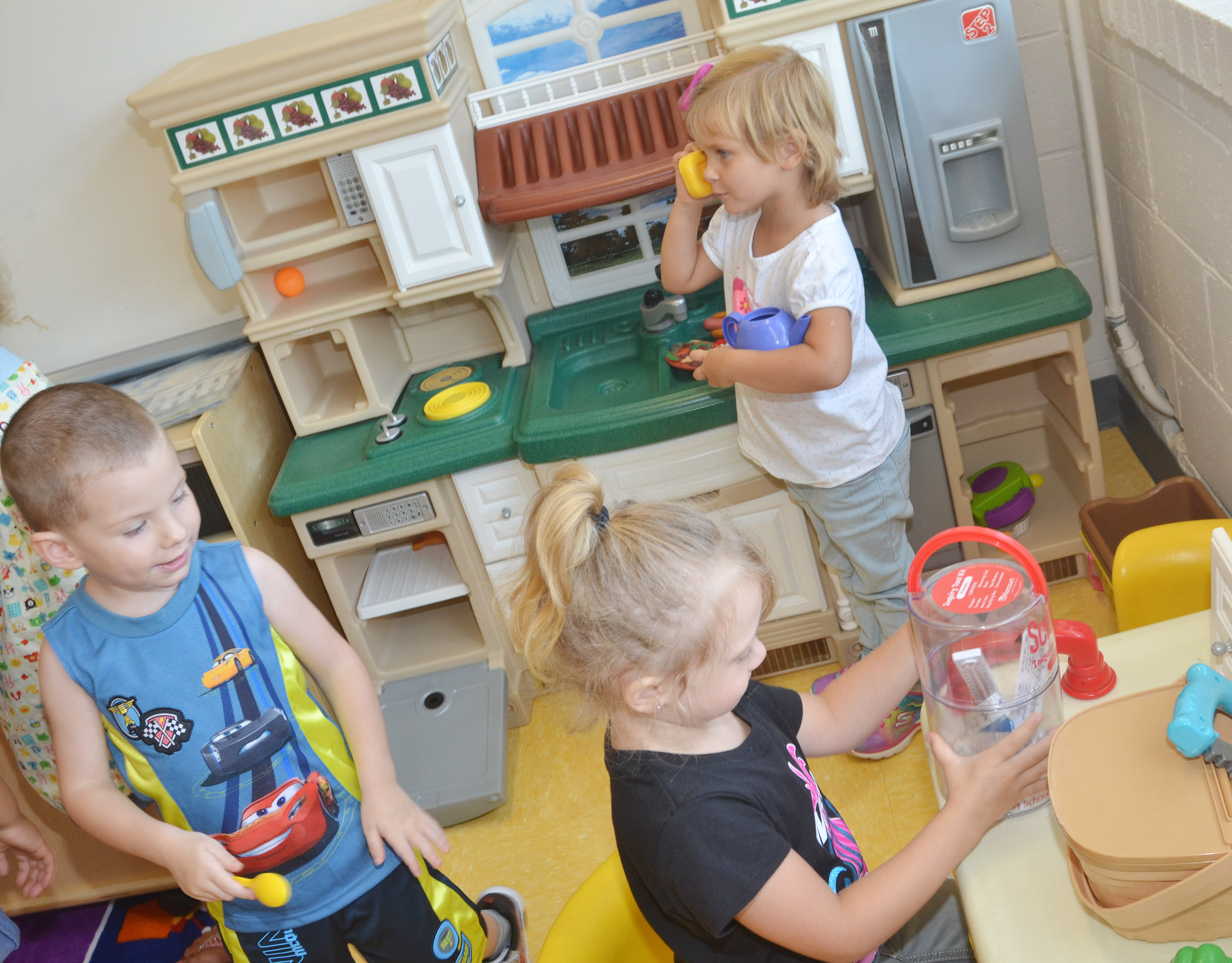 From left, CES preschool students Chase Arnett, Aubree Hall and Elliana Morton play together.