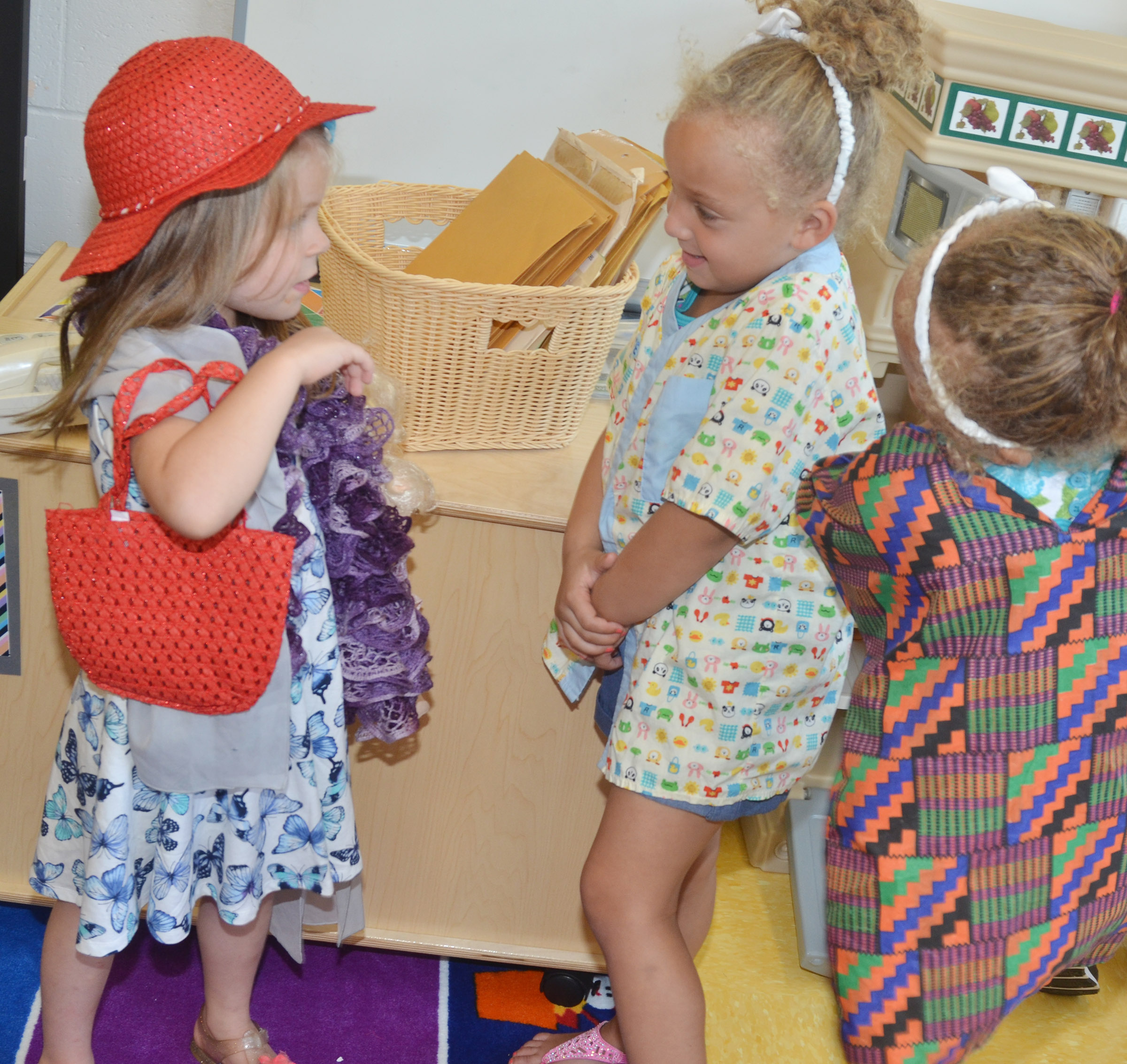From left, CES preschool students Charlotte Coots, Jayla Barbee and Layla Barbee dress up.