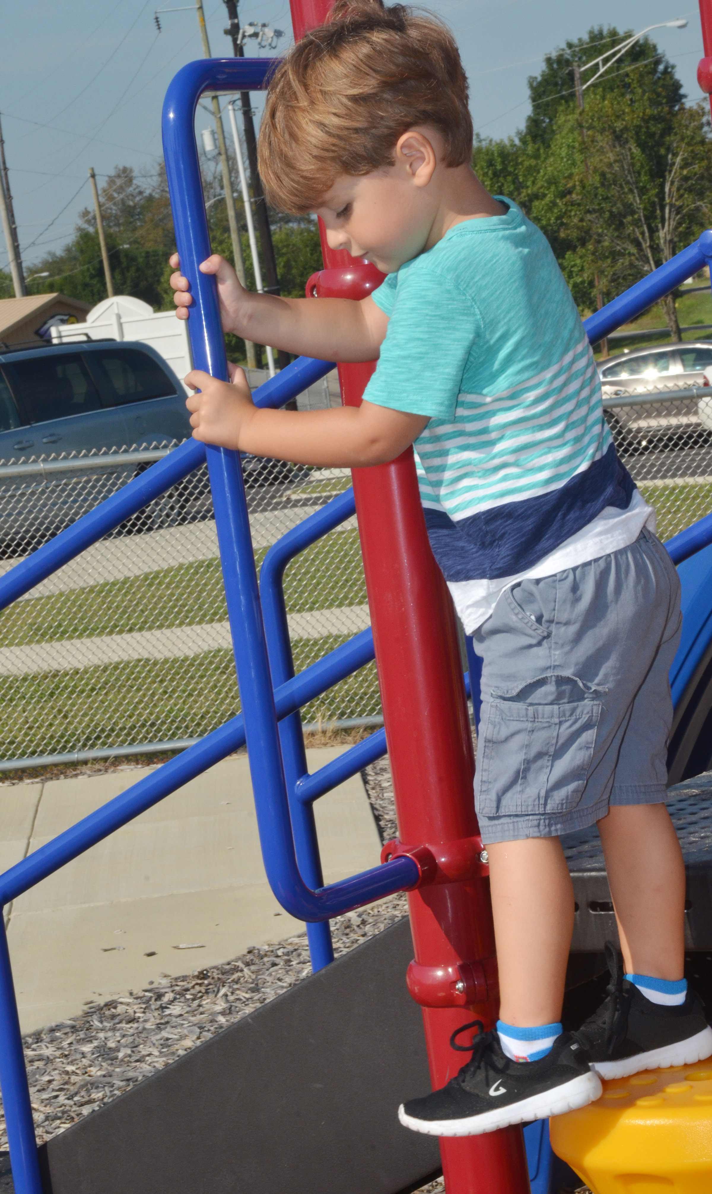 CES preschool student David Smith climbs on the playground.
