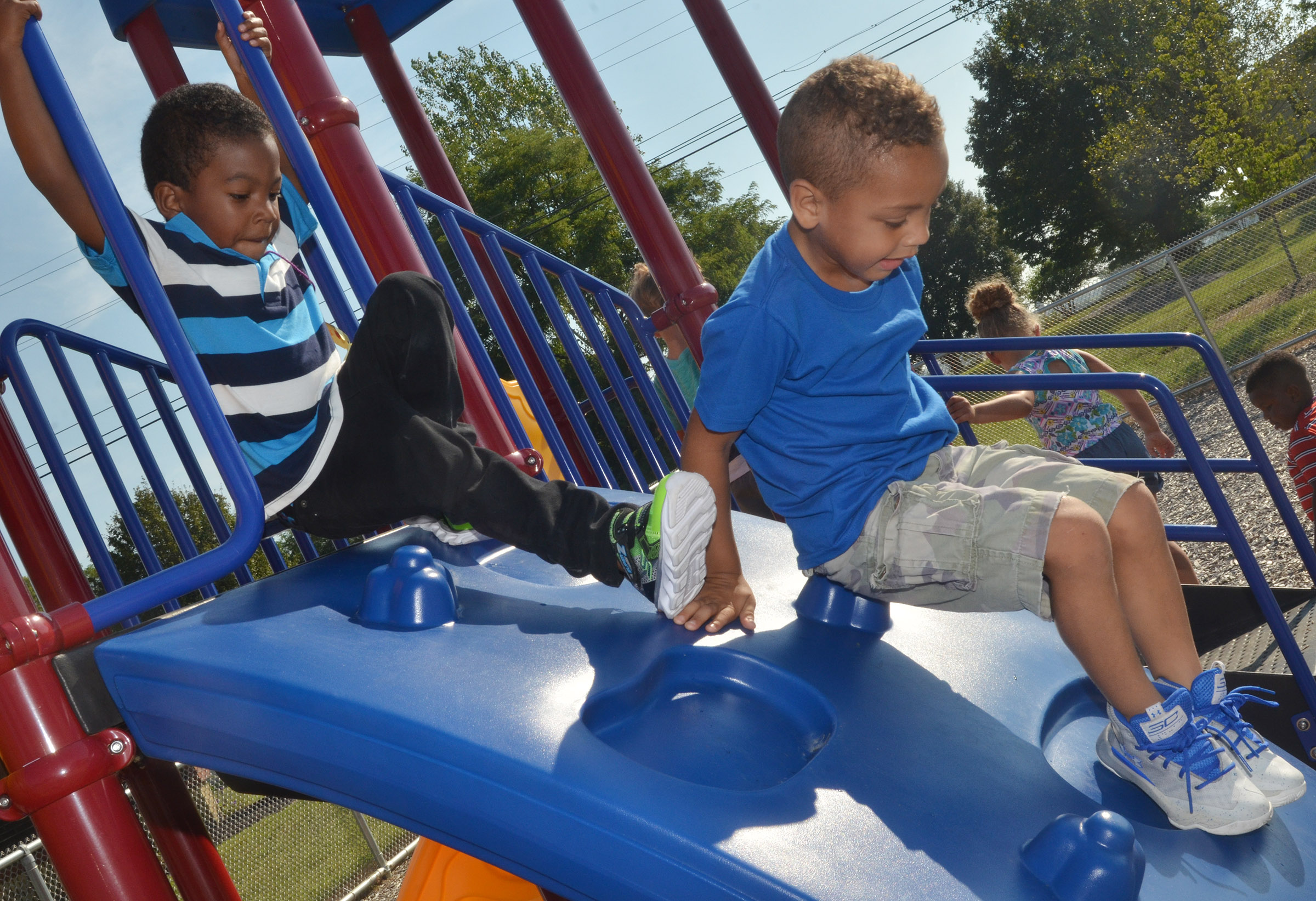CES preschool student Rakim Dunn, at left, and Jasiahas Anderson climb on the playground.
