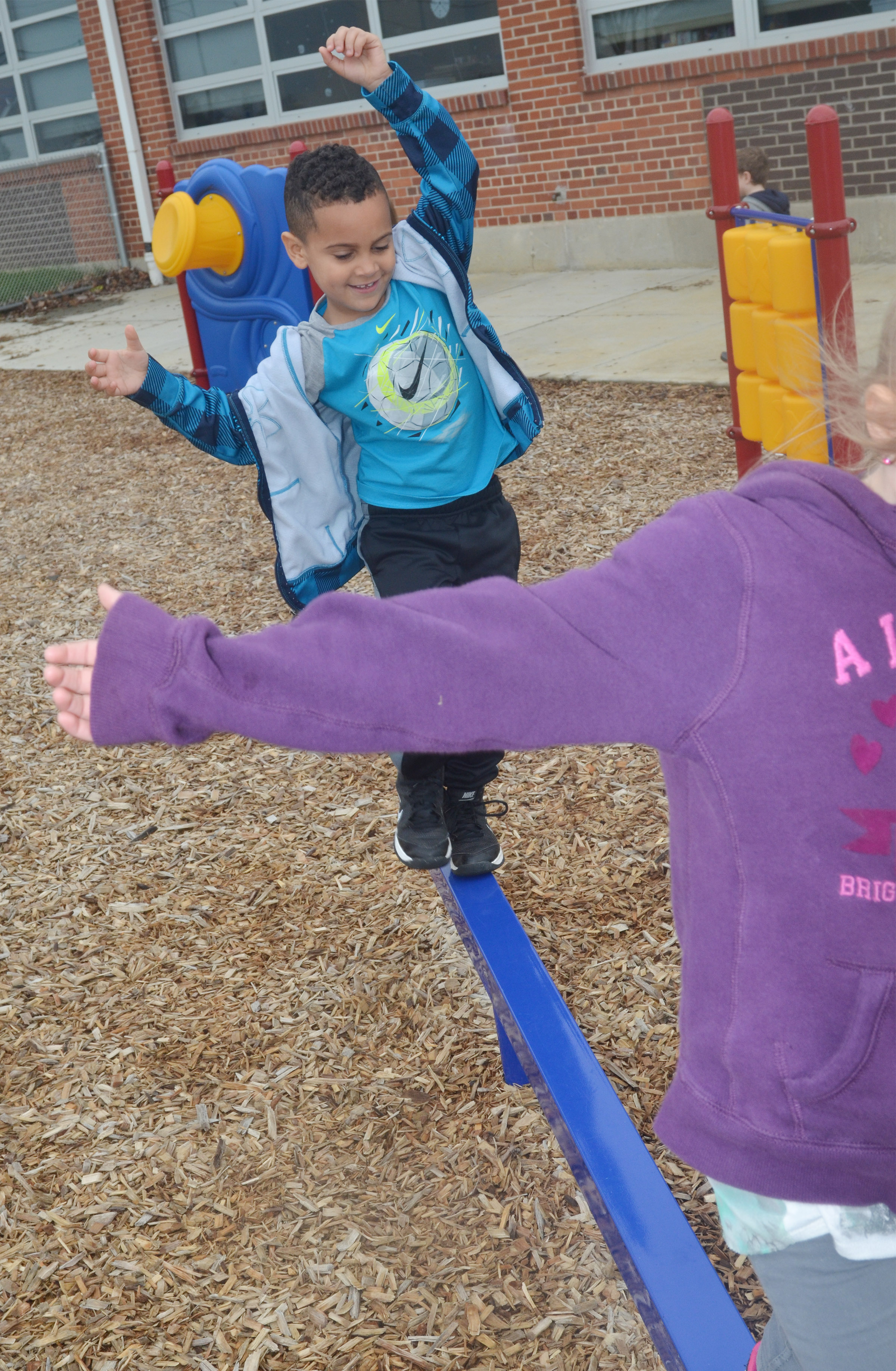 CES preschool student Kingston Cowherd balances on the balance beam as he and his classmates enjoy some playground time.