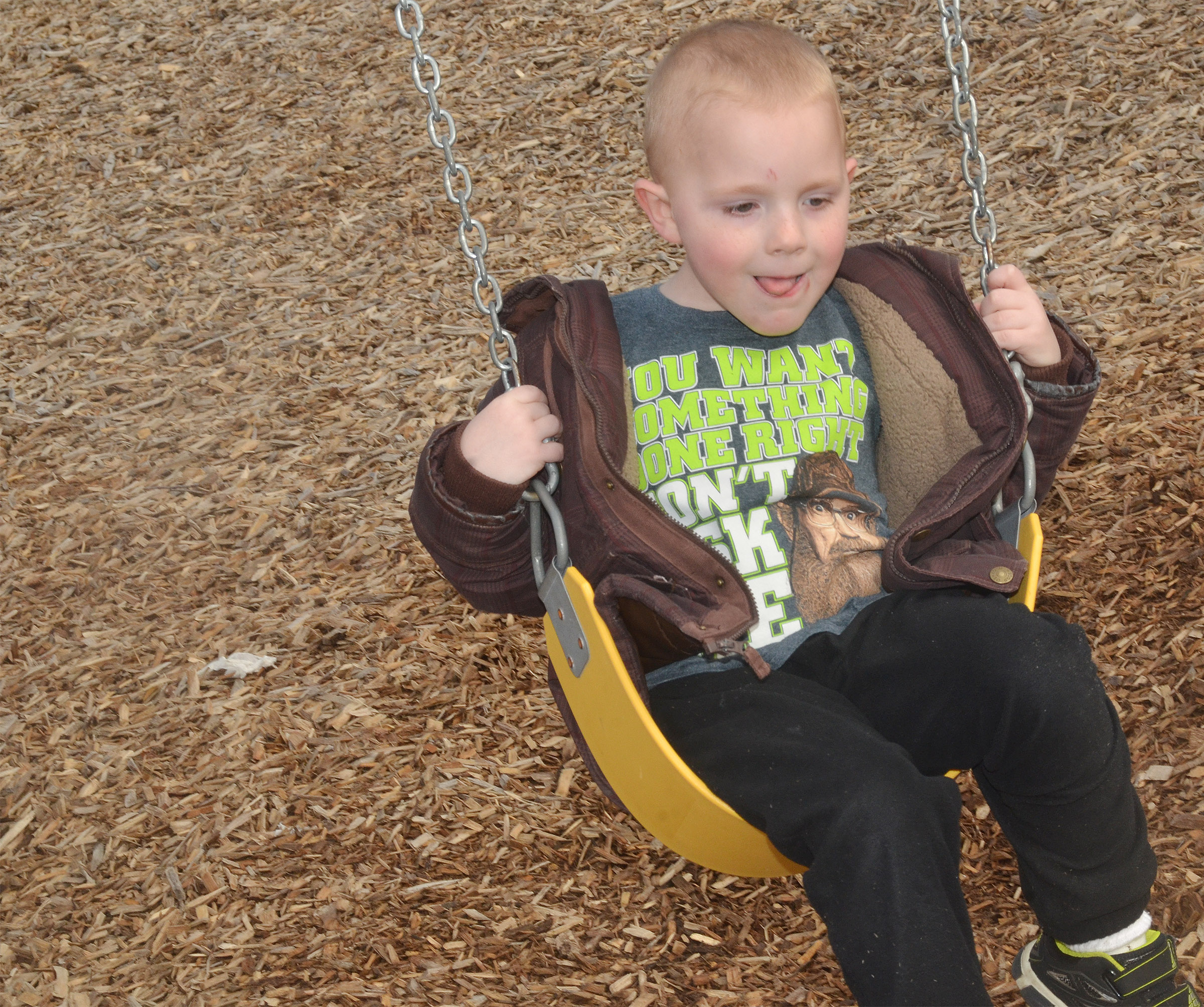 CES preschool student Anthony McClure swings as he and his classmates enjoy some playground time.