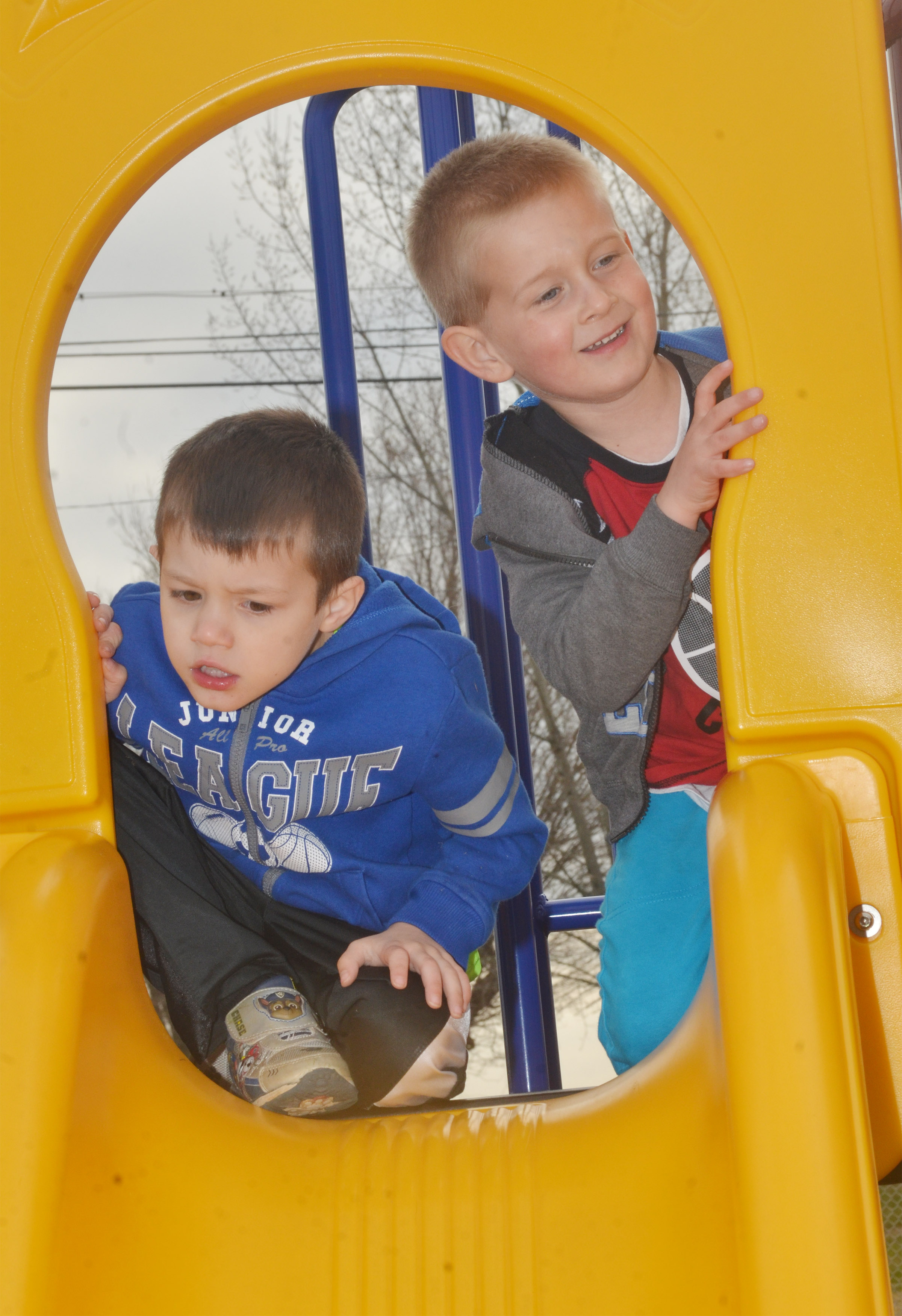 CES students Levi Ritchie, at left, and Jacob Parrish climb as they and their classmates enjoy some playground time.