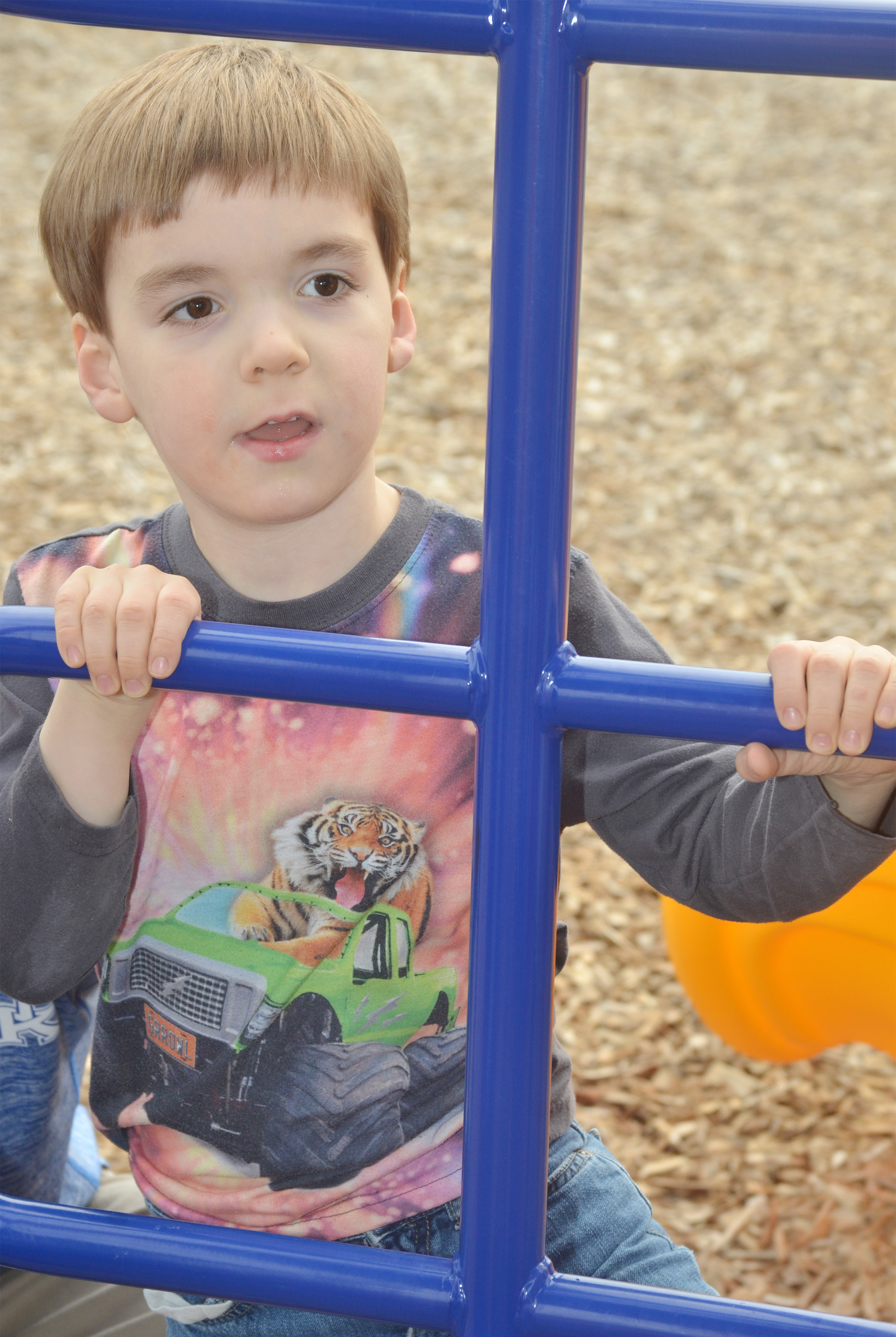 CES preschool student Finley Williams climbs as he and his classmates enjoy some playground time.