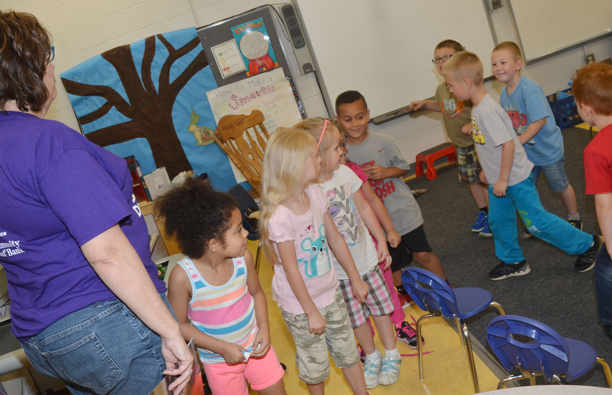 Susan Kennon, a Campbellsville Family Resource and Youth Services Center liaison at CES, shows students how they will line up to walk down the hallway when in kindergarten.