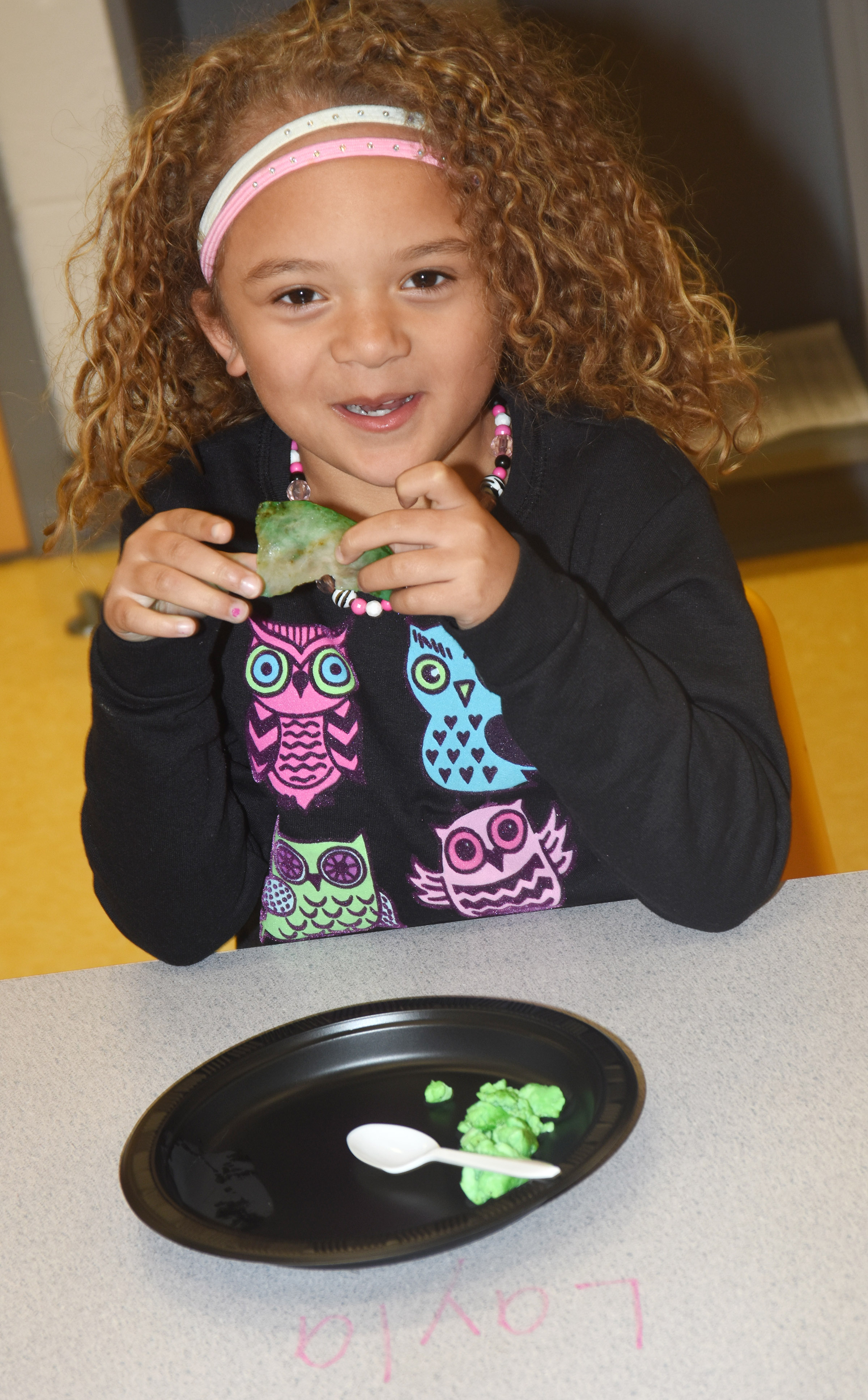 CES preschool student Layla Barbee enjoys green eggs and ham.