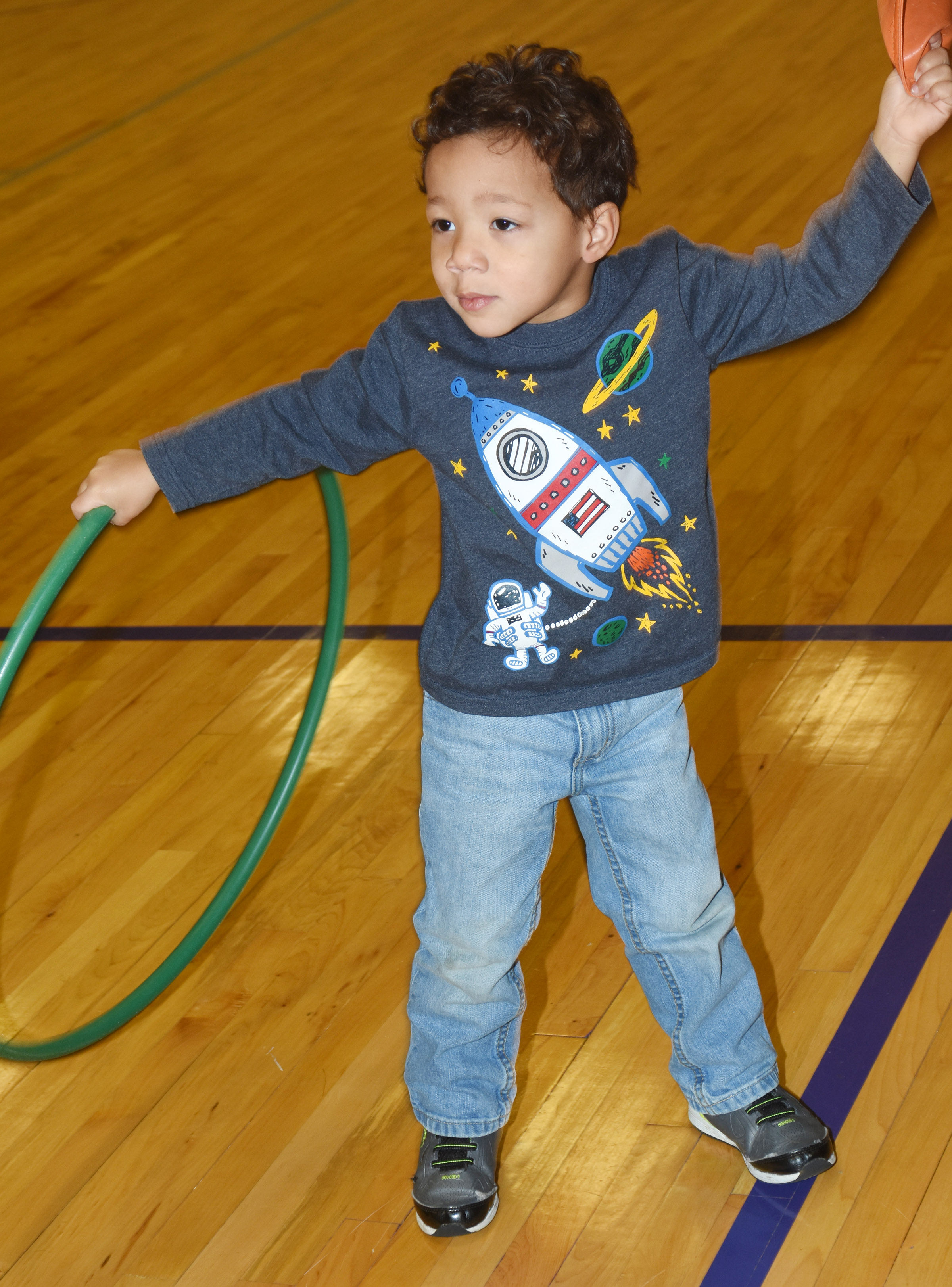 CES preschool student Ace Turner has fun with a hula hoop.