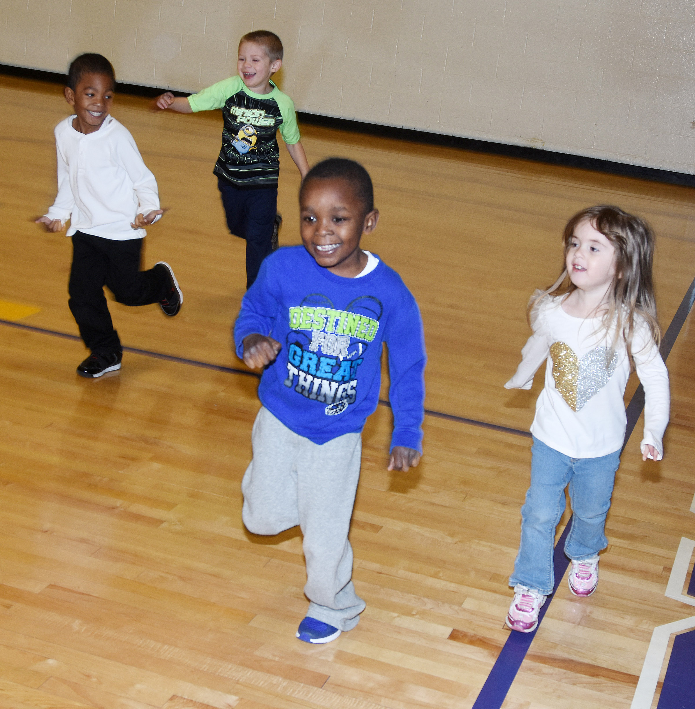 From left, CES preschool students Rakim Dunn, Brian Daniels, Xavien Smith and Ella Woodbury dance together in the gym.