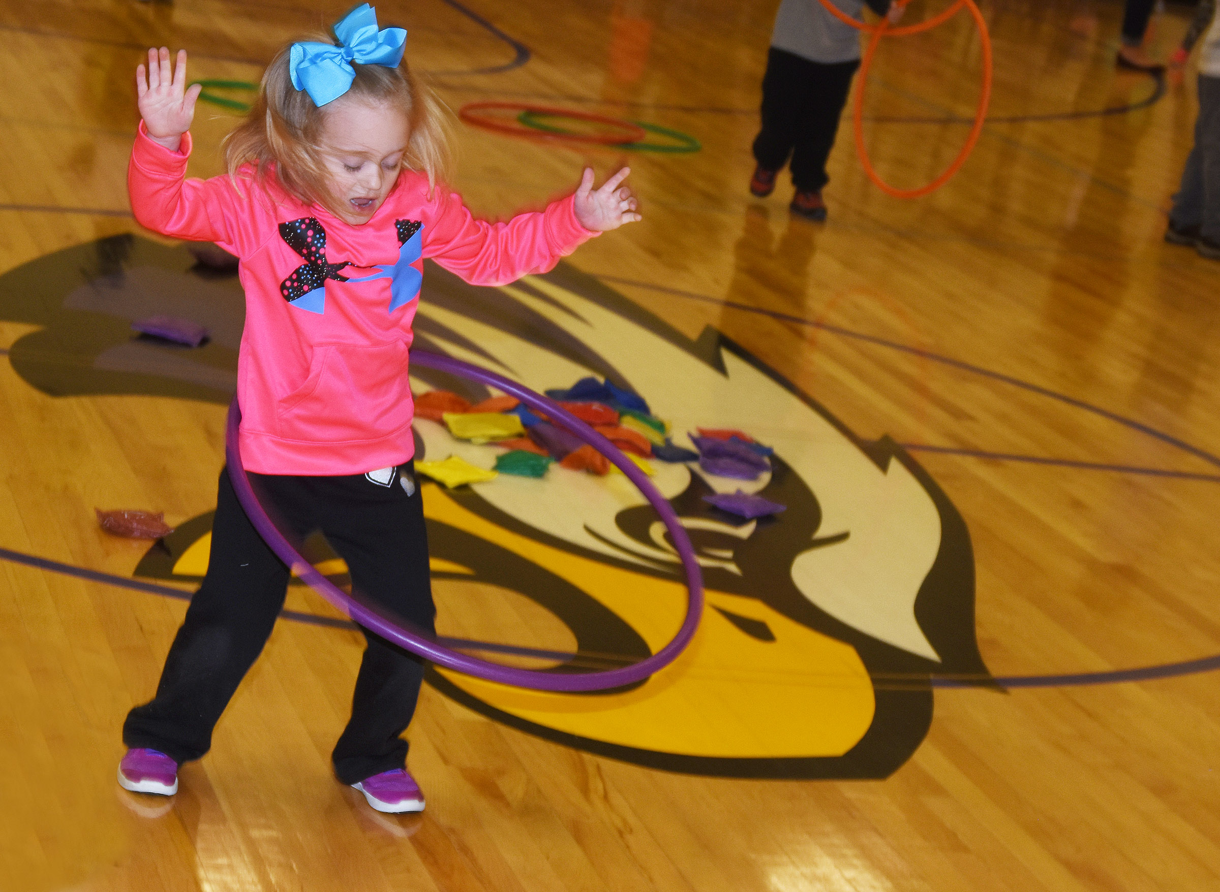 CES preschool student Kylie Thompson hula hoops.
