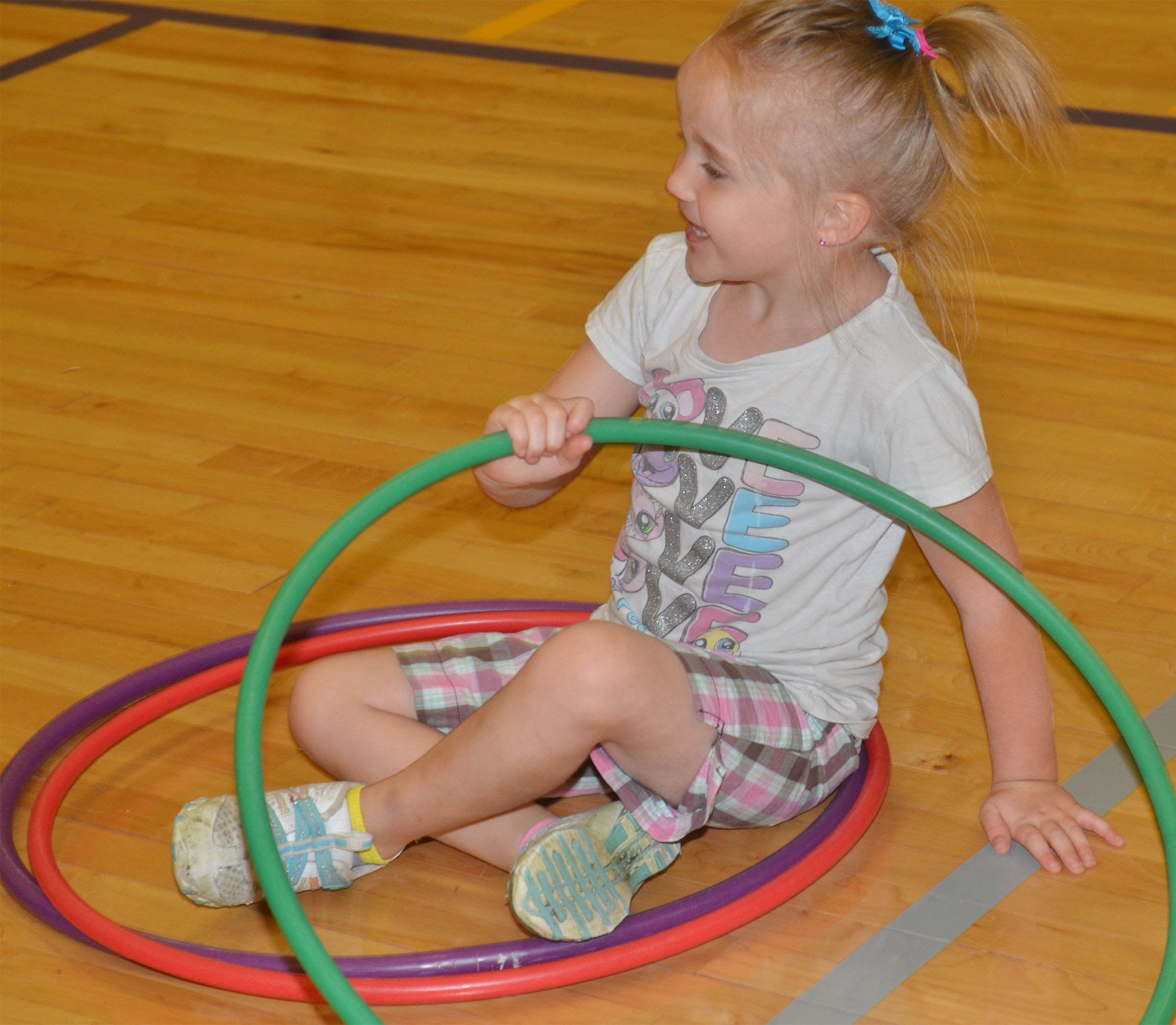 CES preschool student Trinity Dye plays with a hula hoop.