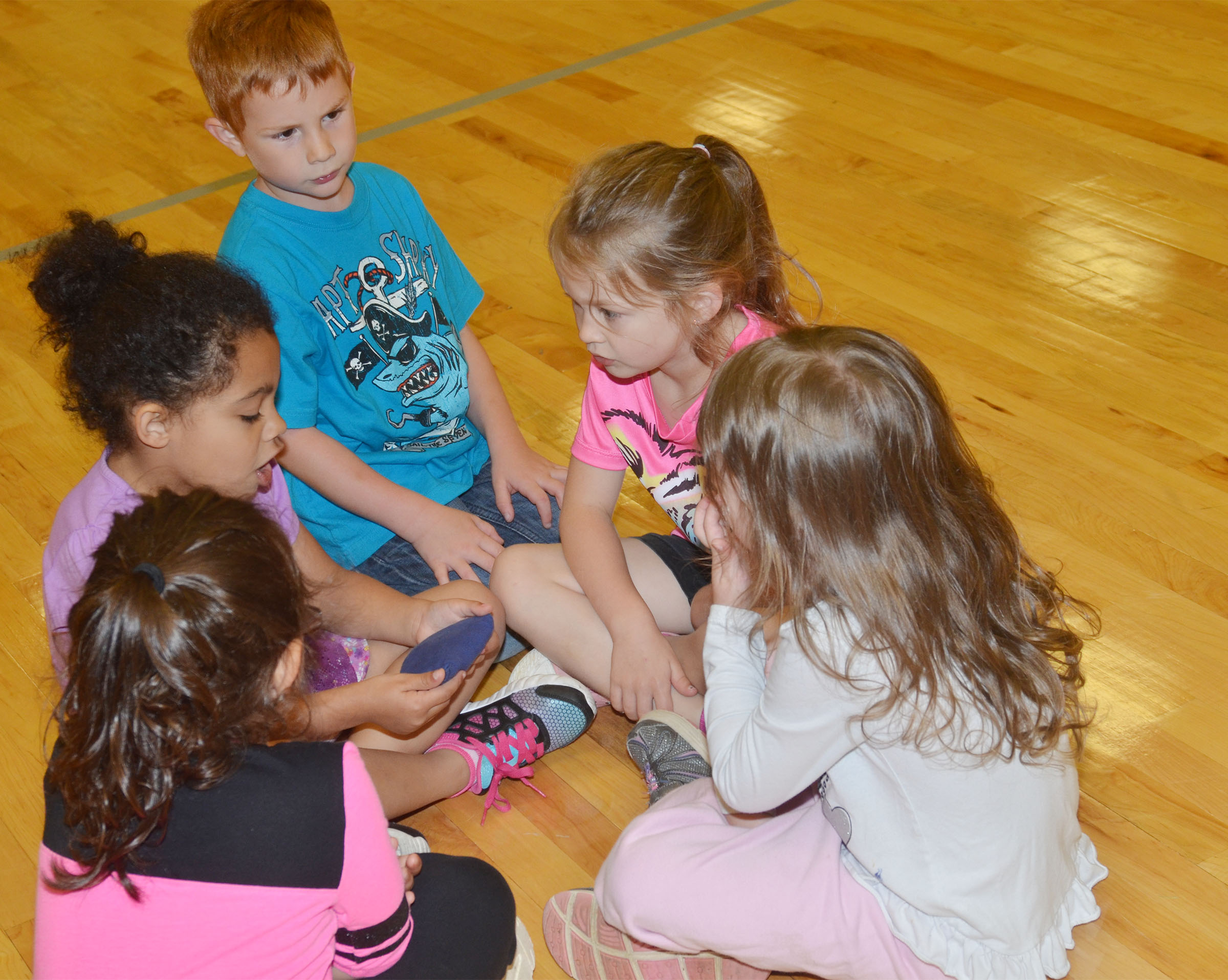 CES preschool students Kennon Dotson talks with his friends.