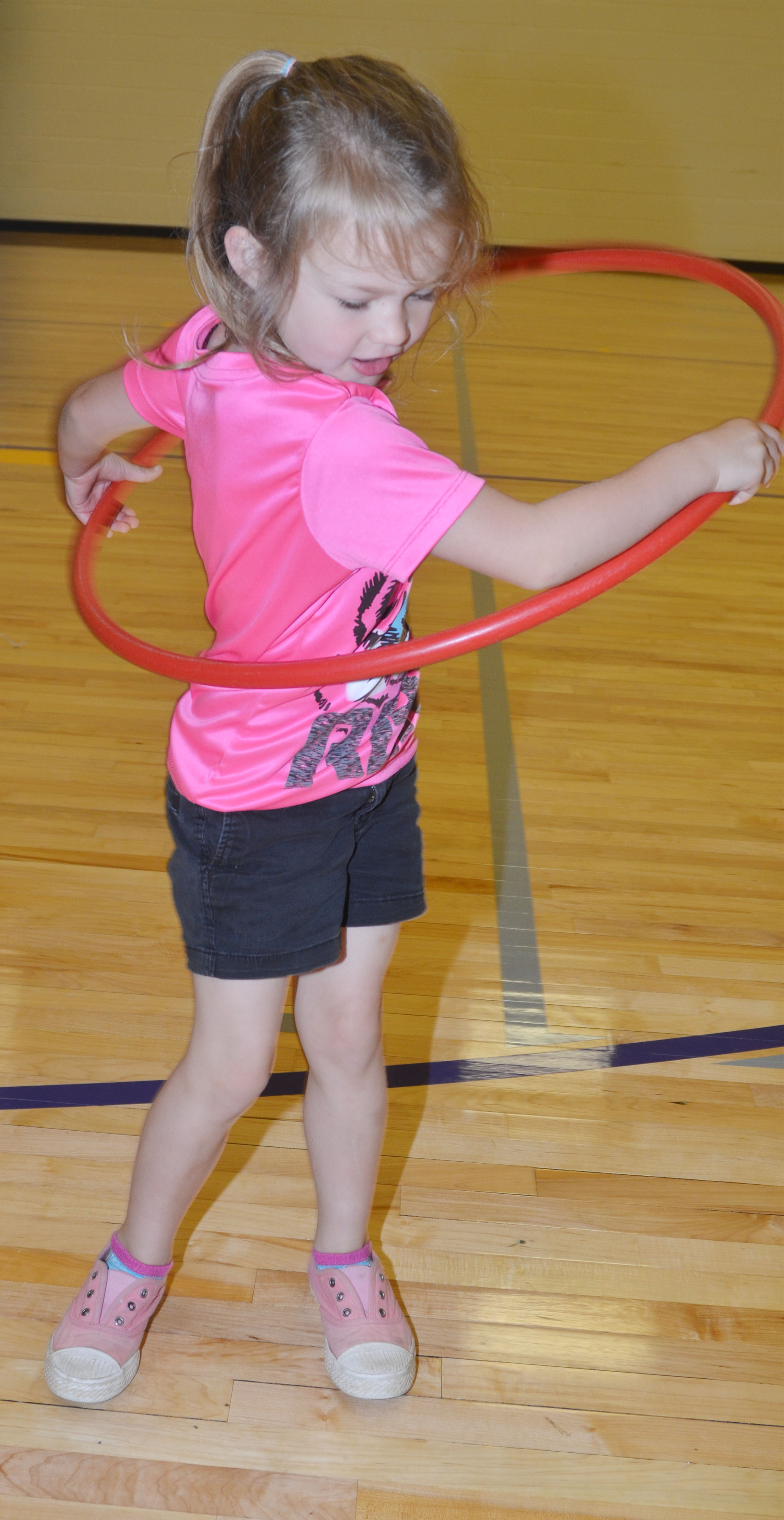 CES preschool student Lilly Spencer plays with a hula hoop.