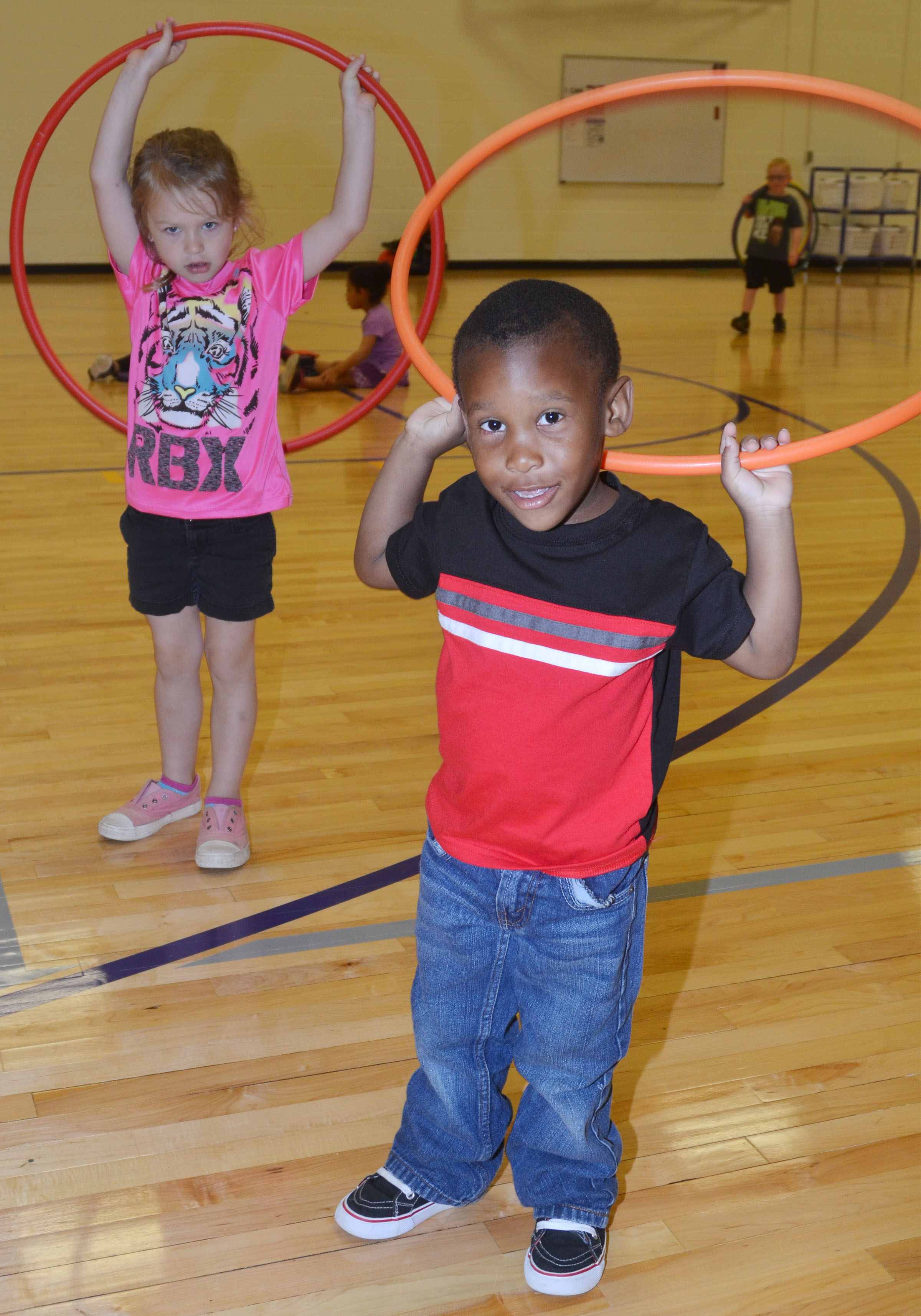 CES preschool student Mason Conner plays with a hula hoop.