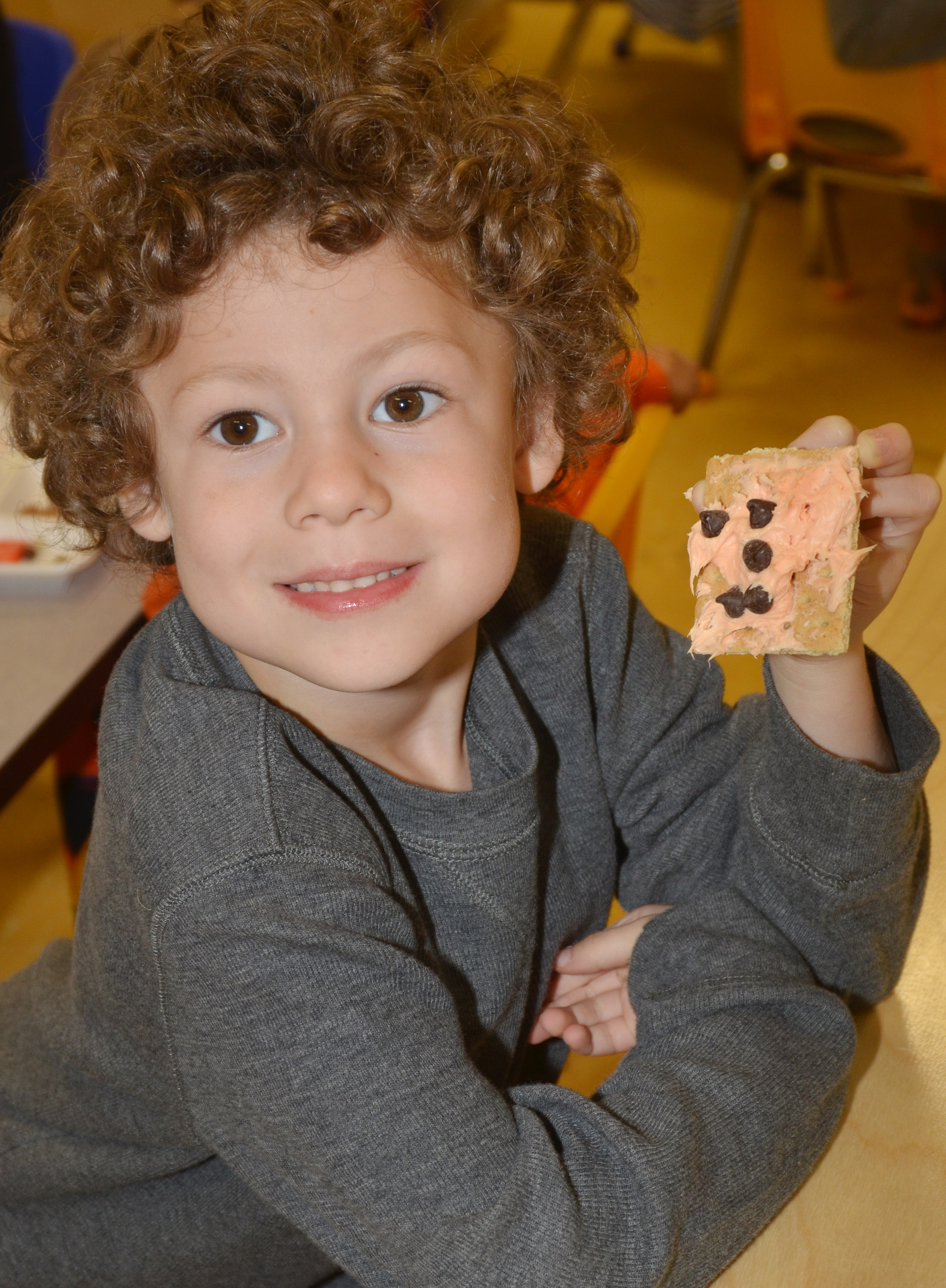 CES preschool student Zyron Young holds his monster cookie.