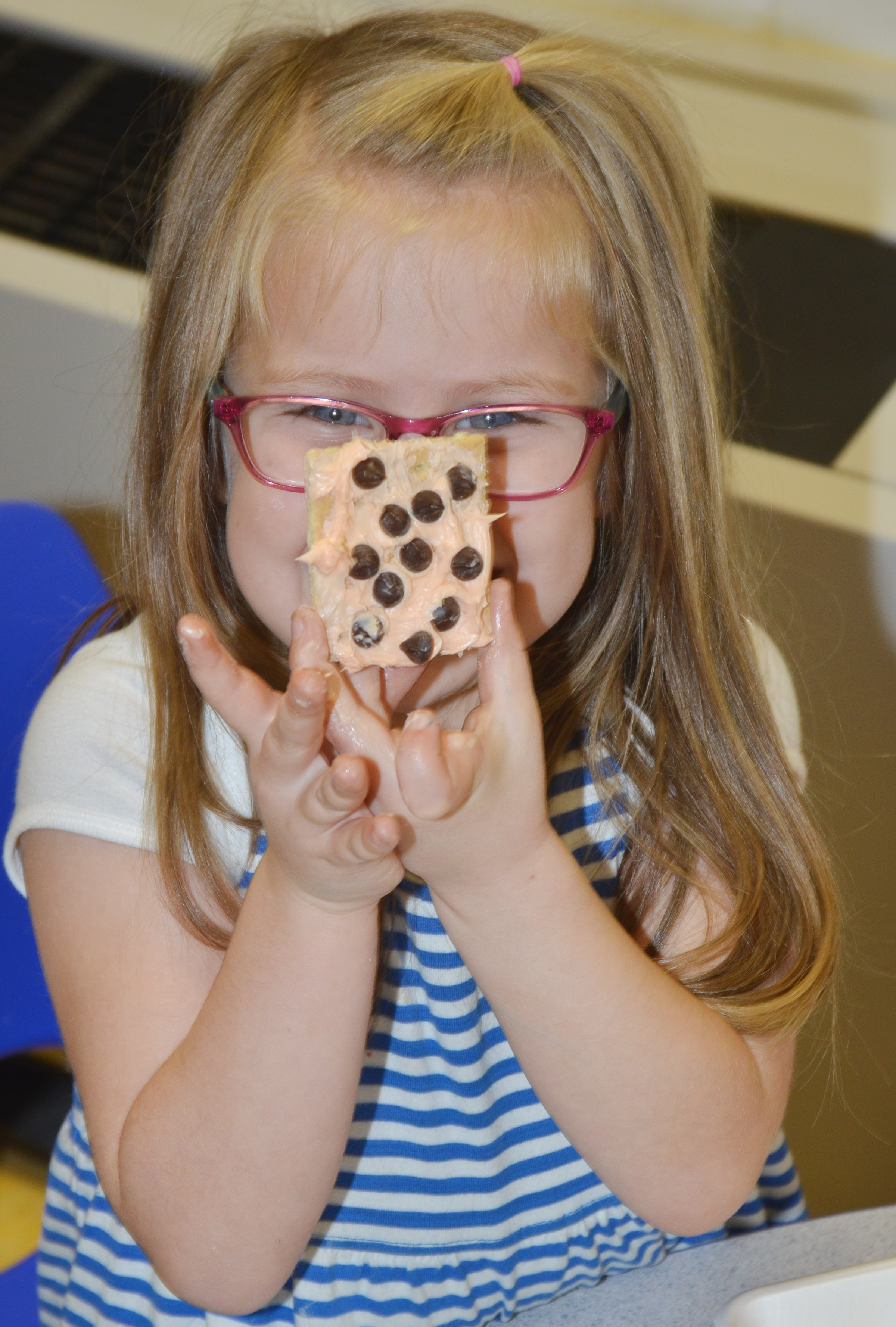 CES preschool student Charlotte Coots holds her monster cookie.