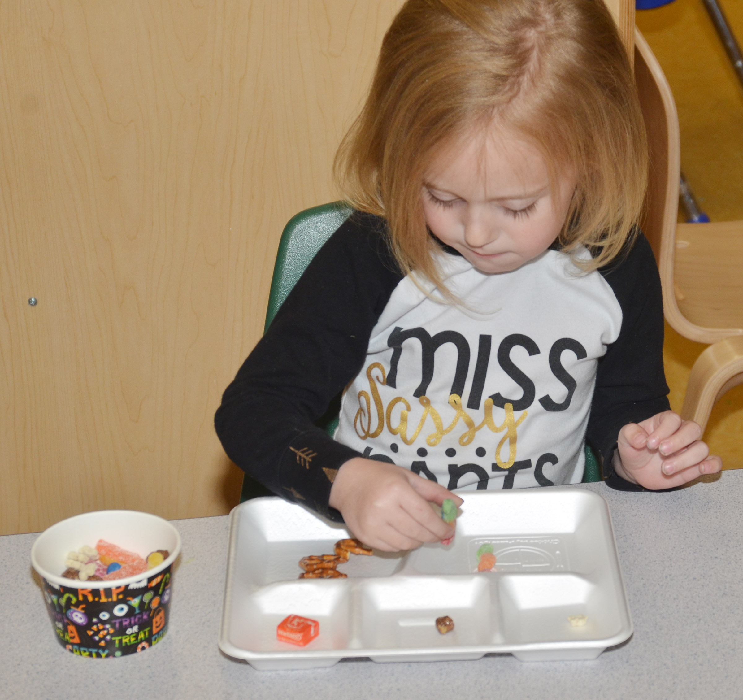 CES preschool student Kylie Thompson sorts her candies.